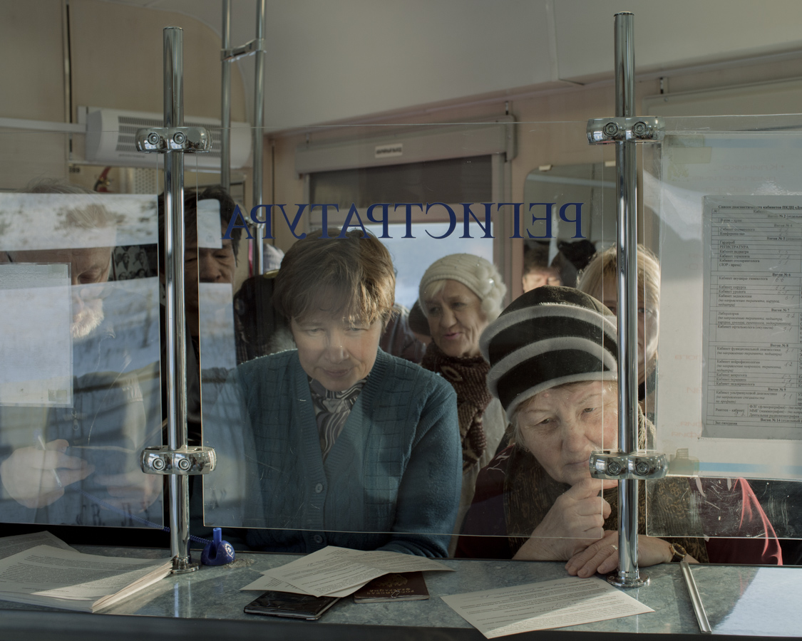 Patients register at the reception