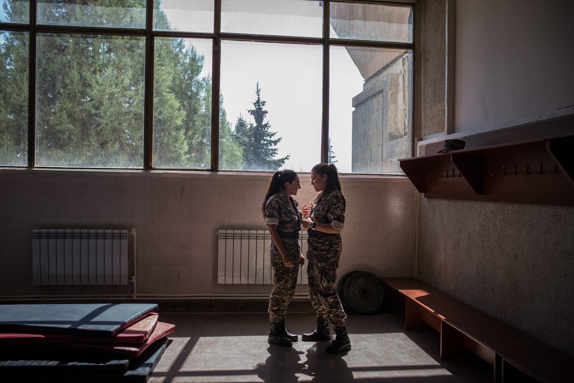 Two girls chatting during free time, Yerevan Military University.