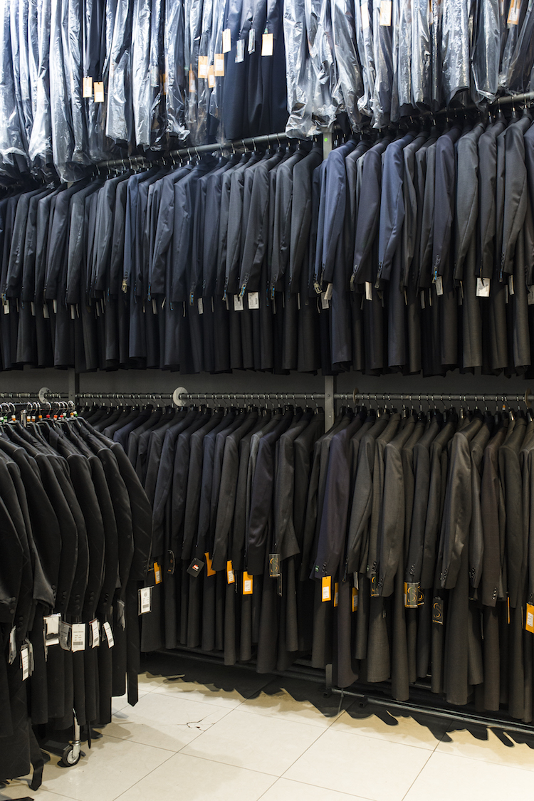 Dozens of black suits in a Ultra Orthodox Haredim clothes shop seen in Meah Shearim on 9th January,2017 in Jerusalem. Yeshivish in general, including the new Sephardic generation in Israel that became influenced by the Yeshivish, wear more modern clothing and match it (up to a point) the elegant spirit of European fashion. They wear dark pants, a white buttoned shirt, short suit, tie and a black hat. The Yeshivish ancient Orthodox Jewish Clothing style began during the Enlightenment in the nineteenth century. The secular educated Jews, underestimated the yeshiva students and called them downgrading nick names. Photo by Sebi Berens