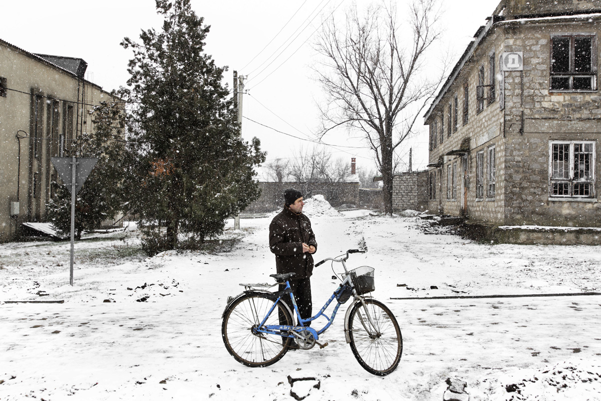 Tomai, Gagauzia. Moldova - Februrary 2018A man waiting under the snow before going to the house of culture of Tomai. Around 500 people attended to the house of culture of Tomai to discuss with local authorities the integrity of Gagauzia inside Moldova and to express their opinions against the reunification between Moldova and Romania. This meeting was in response to the Union Declarations with Romania, which came from around 60 mayors from Moldova.