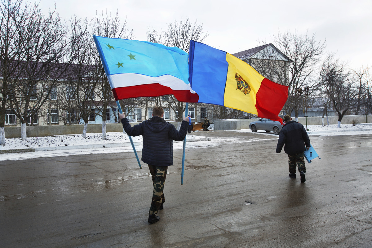 Beshalma, Gagauzia. Moldova - Februrary 2018Flags of Gagauzia and Moldova are returned to their place at the end of the commemoration day on the memory of those soldiers whos lost their lives during the Afghan war.