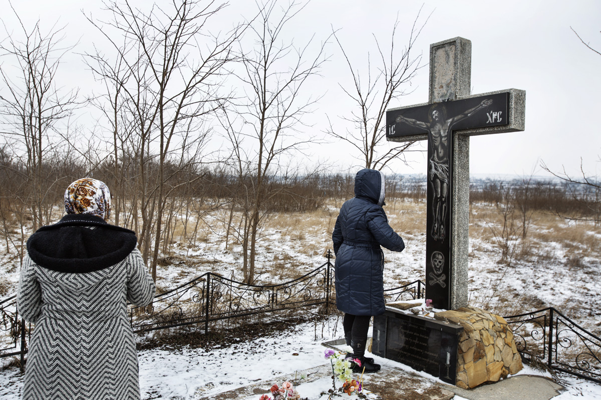 Beshalma, Gagauzia. Moldova - Februrary 2018Two of the women's veterans at the common grave where many people where buried as a consequence of the big famine from 1946. The estimation is that almost half of the village's population (2500 people) died because of starving.