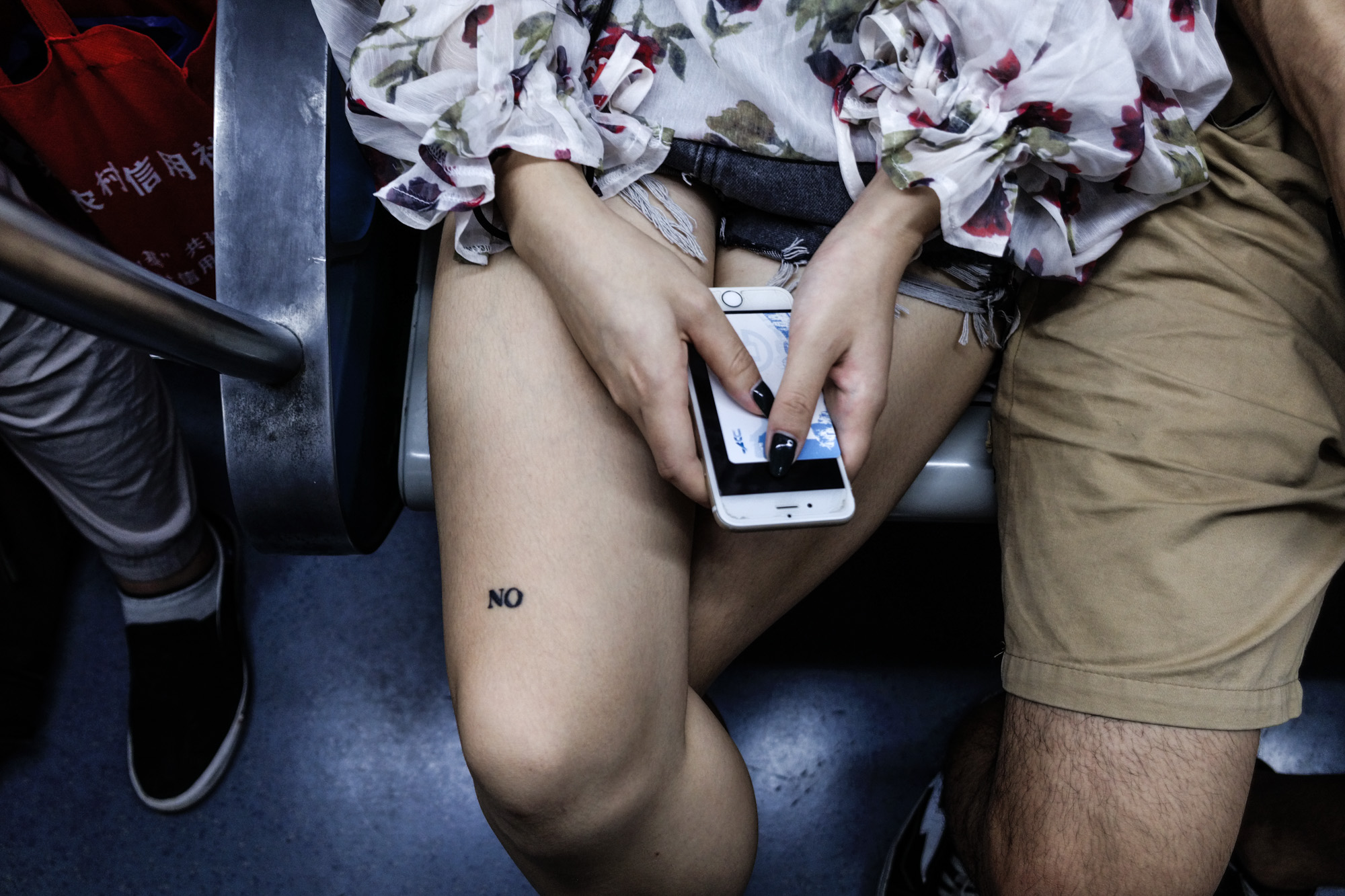 Girl with a NO/ON tattoo on the subway, Beijing, August 2017