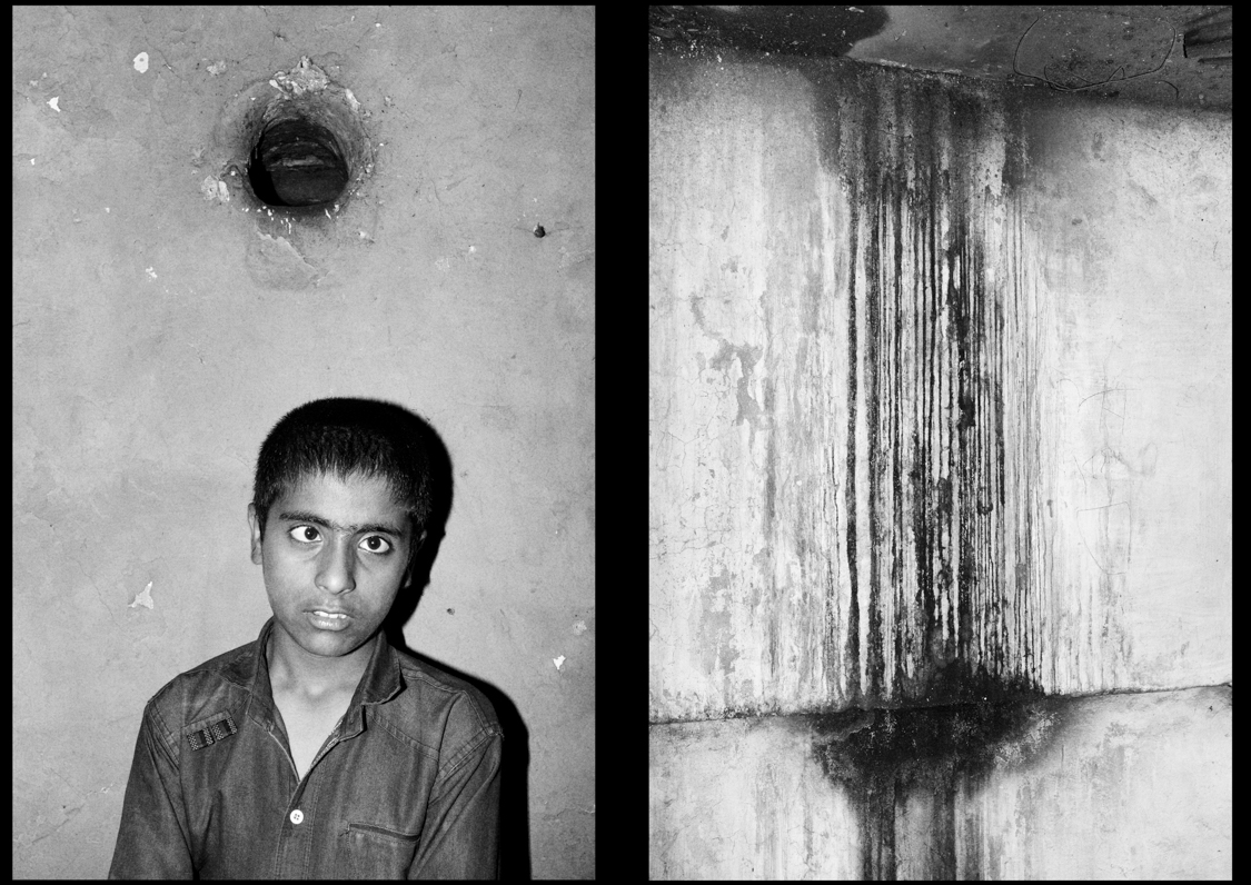 """A boy inside the """"Firdous"""" cinema hall of Srinagar, today abandoned after being occupied by the indian army for 20 years."""
