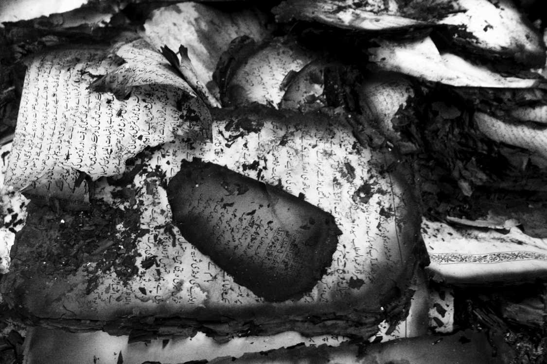 Pages of books burned after a fire destroyed some houses in downtown Srinagar.