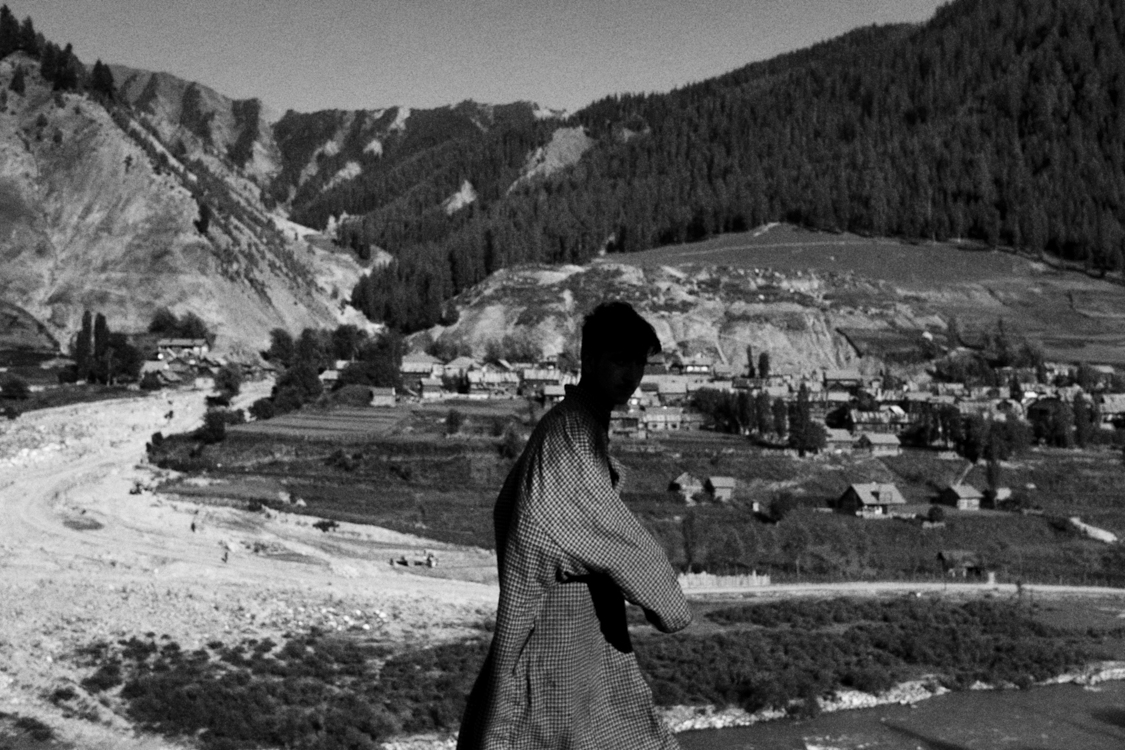A boy walking on the road of Cherwan, one of the last village of the Gurez valley before the Line of Control, the border that divides Indian and Pakistan.