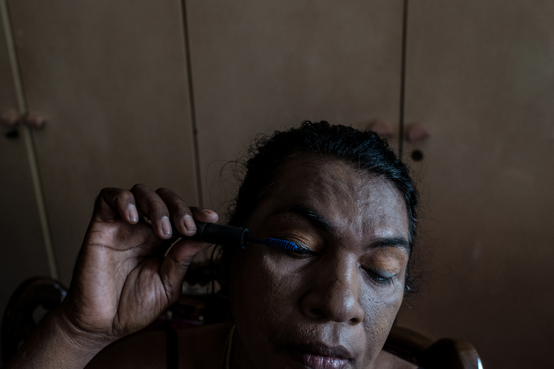 """Mami Yuli, aka Yulianus Rettoblaut, born 1961, is the leader of Indonesian waria, an """"umbrella"""" word, that stands for transgender and transvestite people. For religious reasons, many are not interested in sex-reassignment surgeries as they believe they were born as men and must return to God as men. So does Mami Yuli. Make-up, dress-up and attitude are the ways through which they try to align body and soul. Jakarta, Indonesia, 21st February 2013."""