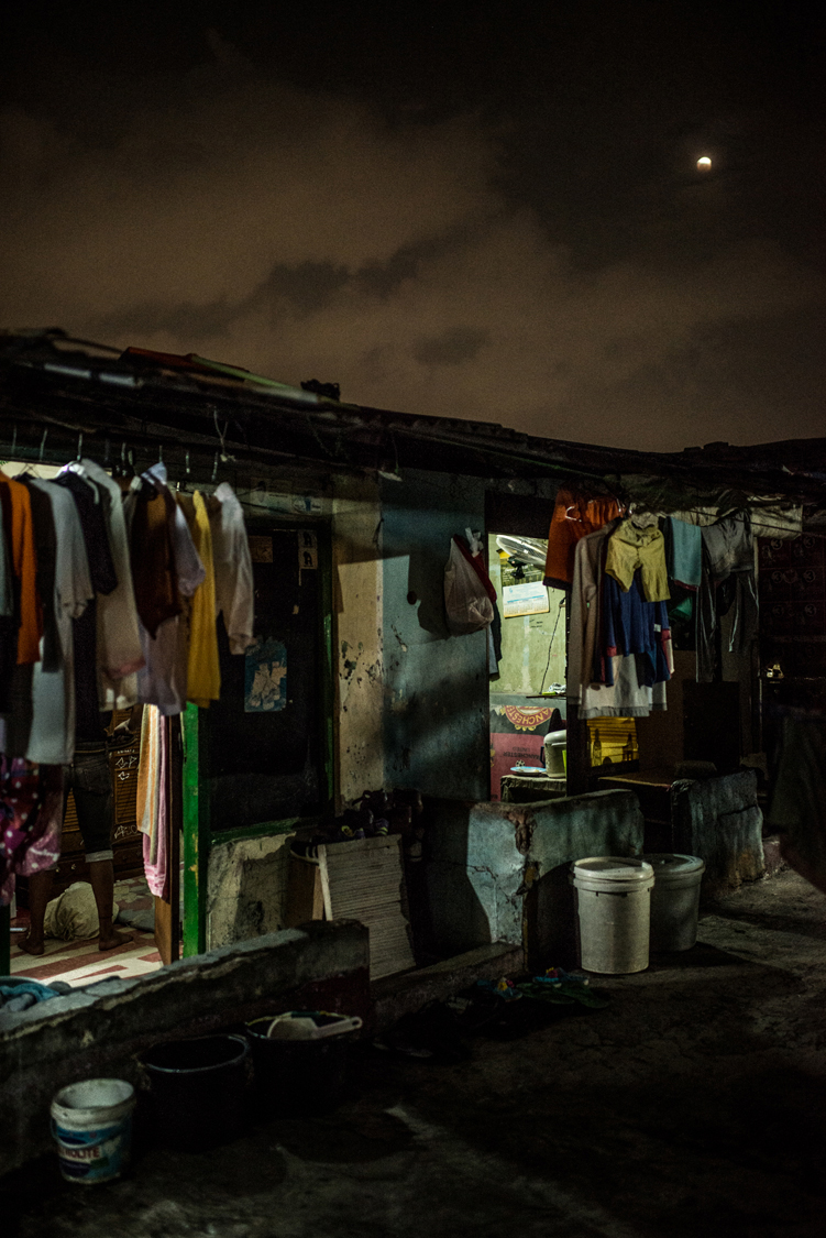 """A rooftop in central Jakarta with rental rooms occupied by waria people sex workers is enlighted by the reddish light of the """"blue blood moon"""" in 2018. Jakarta, Indonesia, 31st January 2018."""