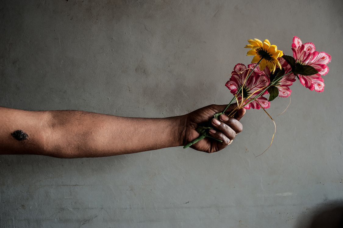 """Mami Yuli, aka Yulianus Rettoblaut, born 1961, is helding a bunch of fake flowers. She is the leader of Indonesian waria, an """"umbrella"""" word, that stands for transgender and transvestite people. Jakarta, Indonesia, 15th November 2012."""