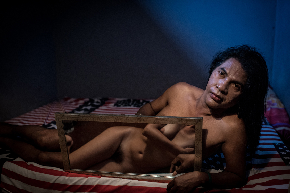 """Mami Yuli, aka Yulianus Rettoblaut, born 1961, is the leader of Indonesian waria, an """"umbrella"""" word, that stands for transgender and transvestite people. For religious reasons, many are not interested in sex-reassignment surgeries as they believe they were born as men and must return to God as men. So does Mami Yuli. Make-up, dress-up and attitude are the ways through which they try to align body and soul. Jakarta, Indonesia, 29th April 2013."""