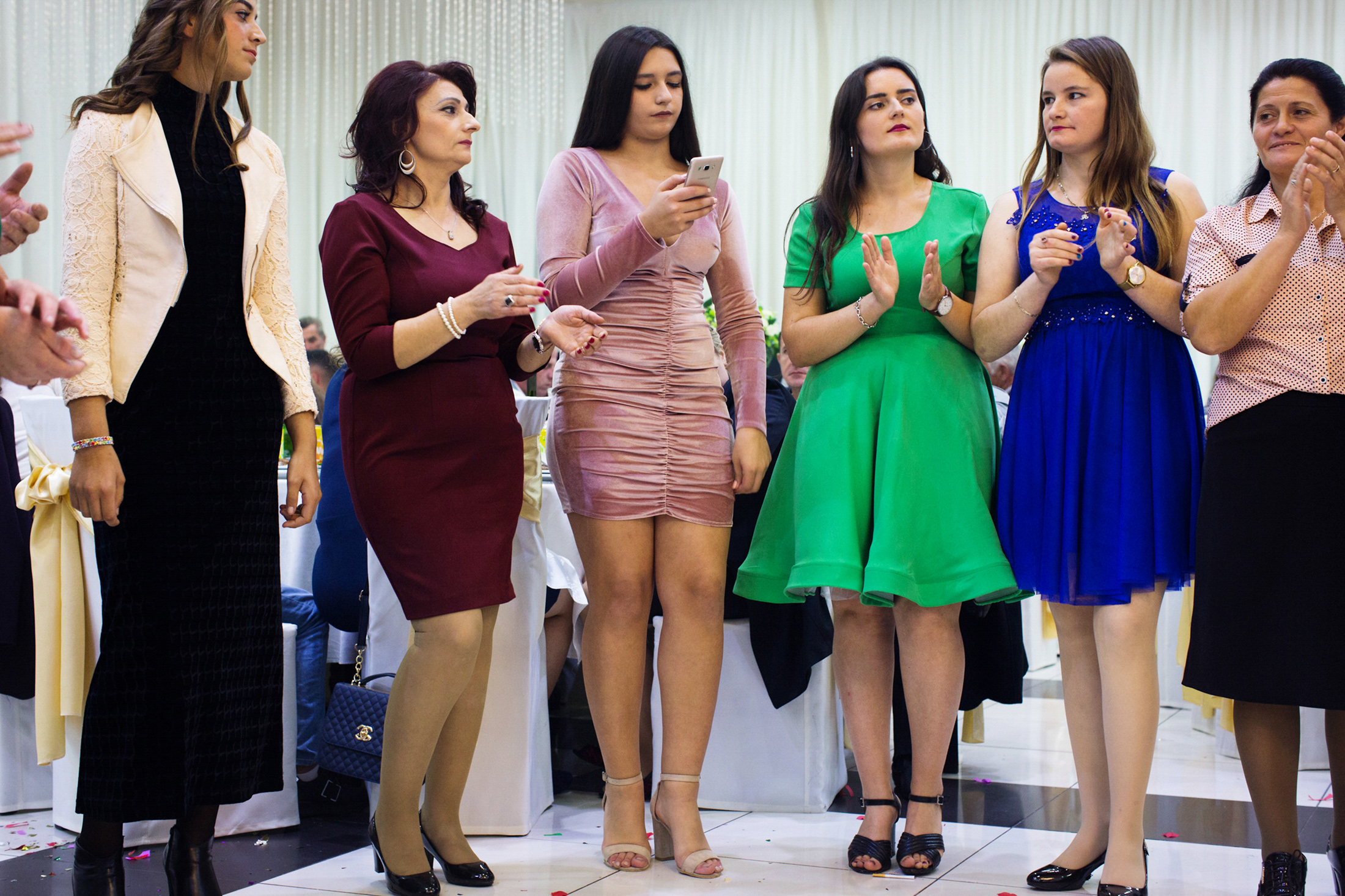 Women are standing in a line at a traditional wedding ceremony in Skodra, Northern Albania.