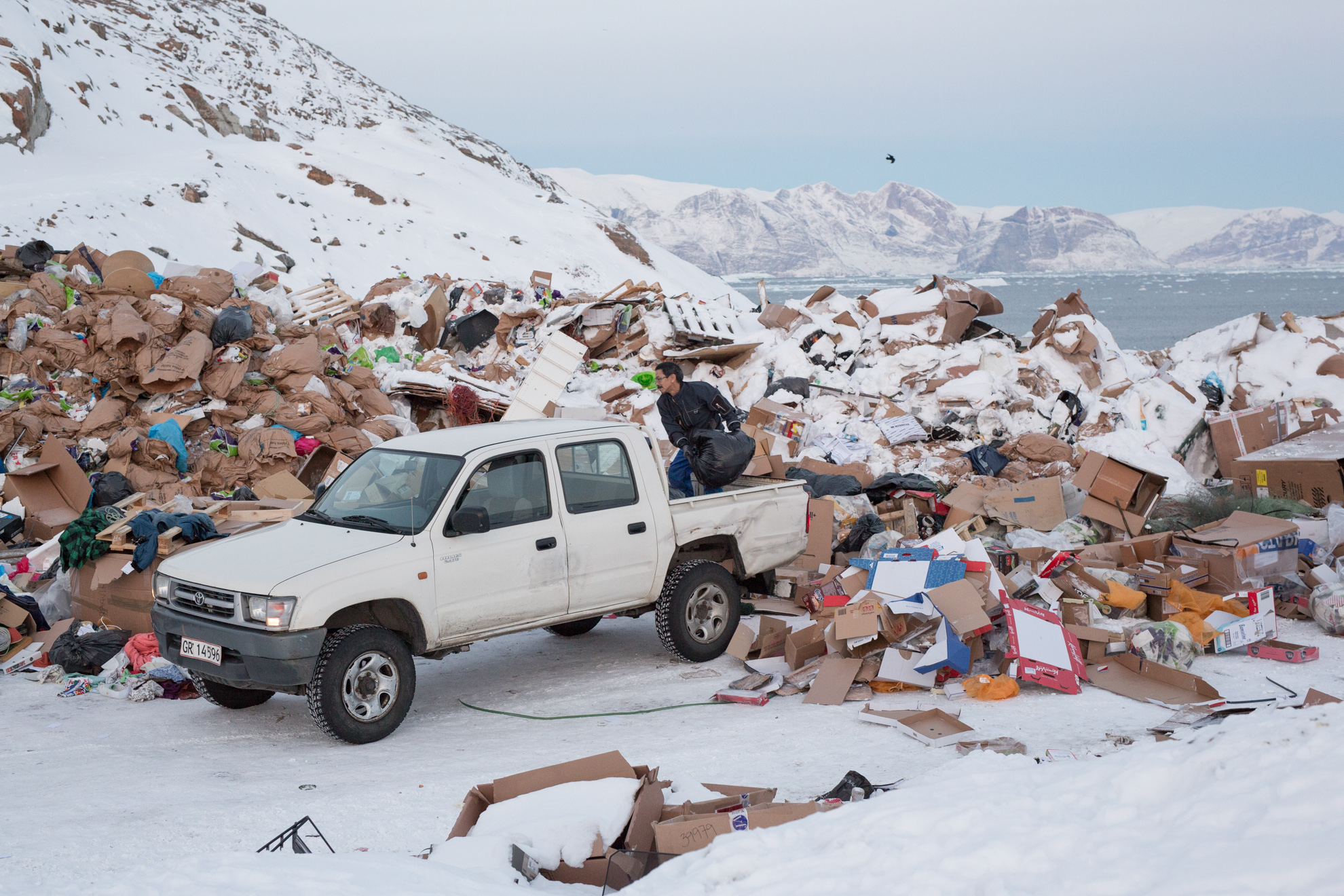 Trash in Uummannaq is dumped and then burned. Feces are collected and then led through a pipe into the ocean. Most old dogs who can't be used for dog sledding anymore are brought to the dump and then shot or strangled. Young puppies often die of diseases and are also dumped here.
