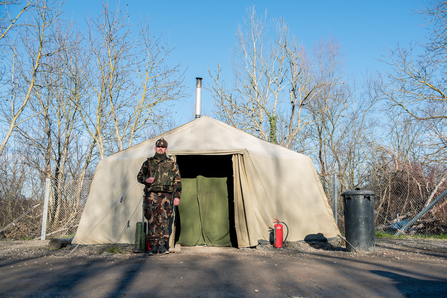 Soldier stands in front of a military warming tent to secure the border between Hungary and Serbia near Hercegszántó Hungary 24 December 2017. The Hungarian border fence was constructed in the middle of the European migration crisis in 2015, with the aim to ensure border security by preventing immigrants from entering the country and the European Union illegally.