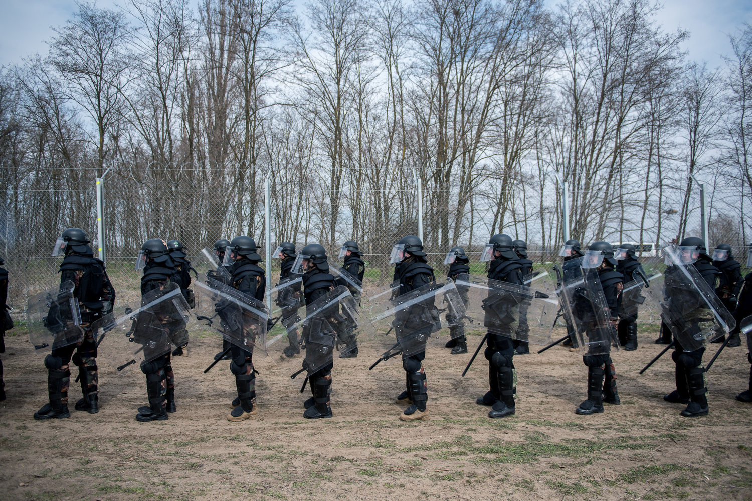 Riot soldiers stand in front of a practice fence at a military practice  near Kelebia, Hungary 22 March 2018. The fence was constructed in the middle of the European migration crisis in 2015, with the aim to ensure border security by preventing immigrants from entering the country and the European Union illegally.