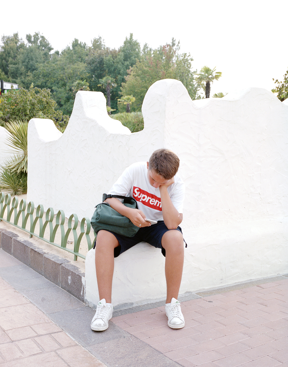 Ronchi, 2017, ItalyA bored youngster inside Gardaland, the biggest fun park in Italy