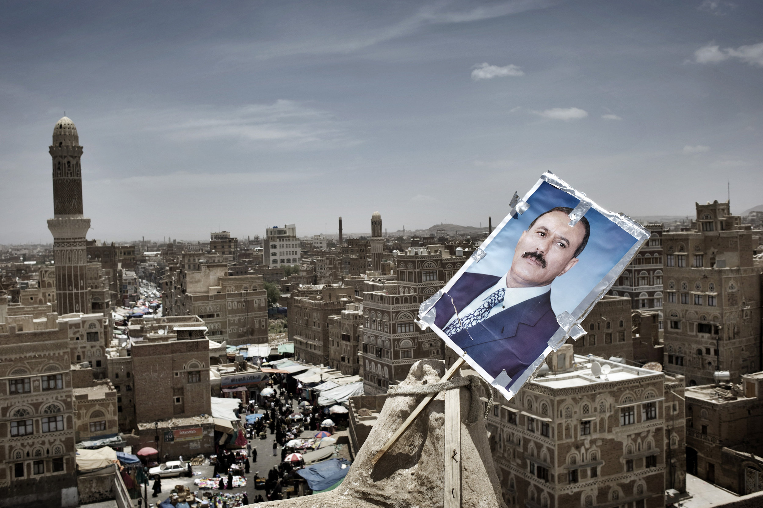SANAA YEMEN-- MAY 2011:   A poster of Yemen's President Ali Abdullah Saleh   is seen  at  the  roof  of  the  house  at  the old  town  of Sanaa