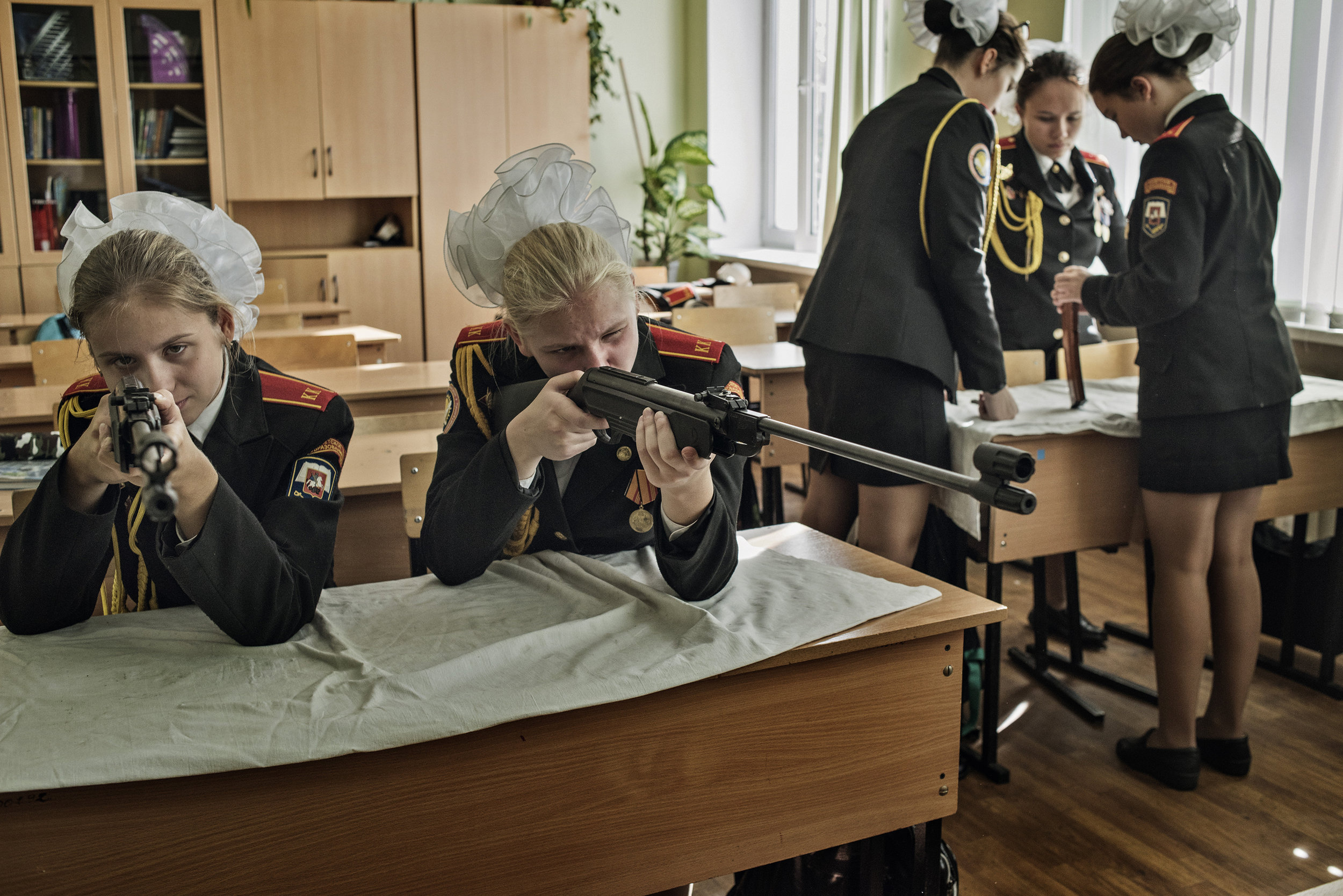 Russia, Moscow, September 2016, Young girls learn how to assemble and shoot rifles at a cadet boarding school.