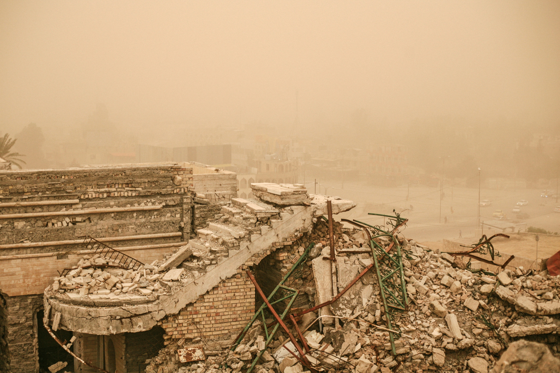 Sandstorm on the ruins of the city with dust. Mosul, Iraq, May 2017.