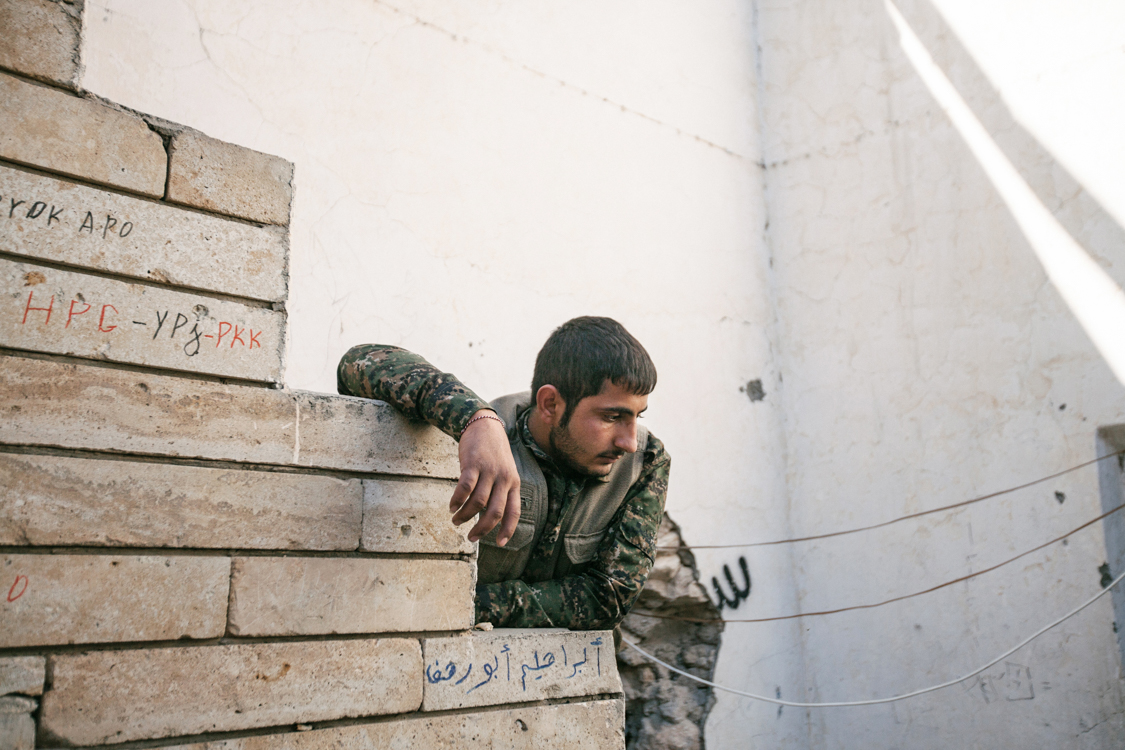 The stare of a YBS fighter seems lost towards death. Sinjar, Iraq, November 2015.
