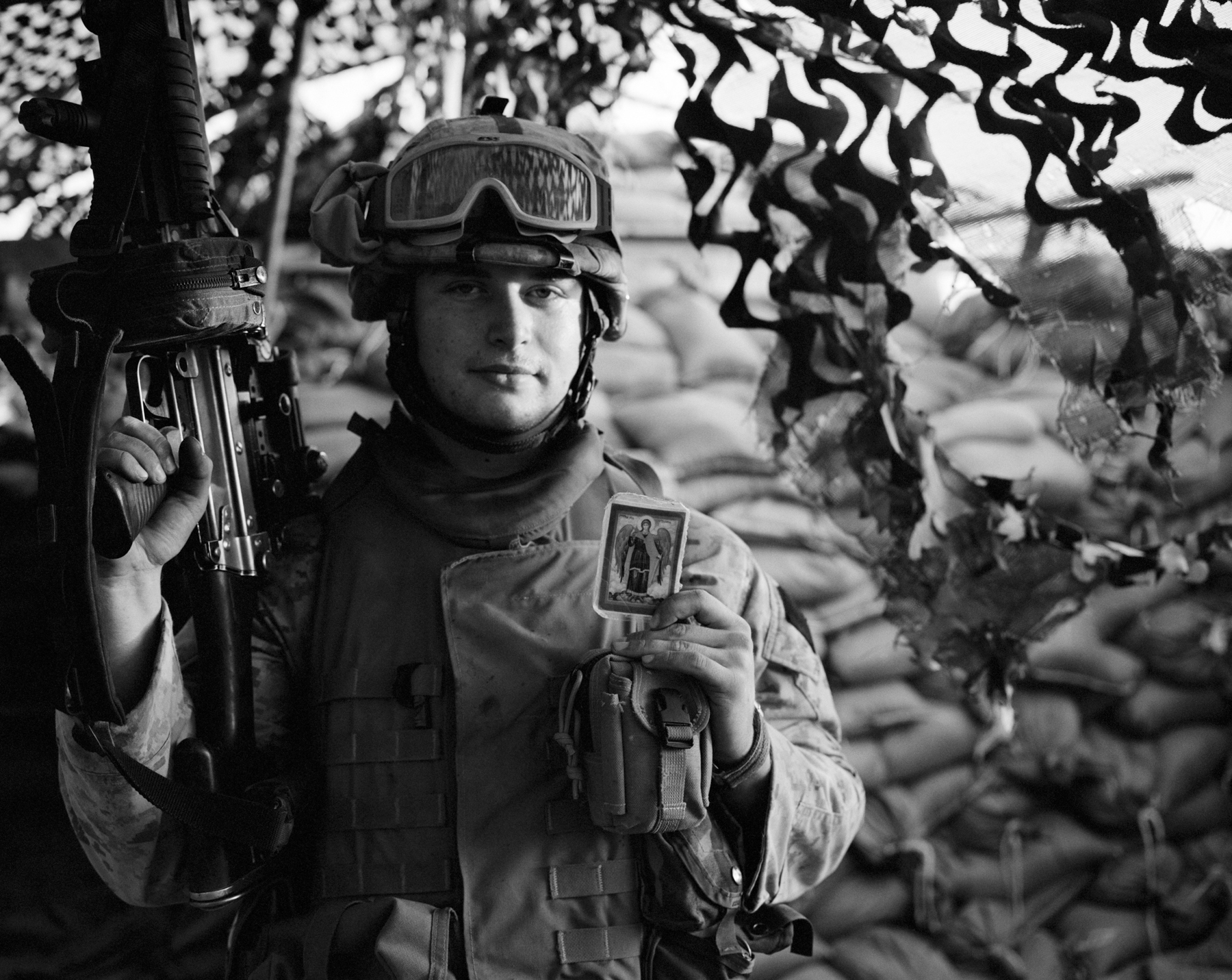 RAMADI- IRAQ-APRIL, 2006:  US Marine LCPL  Anton E Volkov , Brooklyn, NY  from Kilo Company, 3rd Battalion, 8th Marine Regiment shows his talisman.