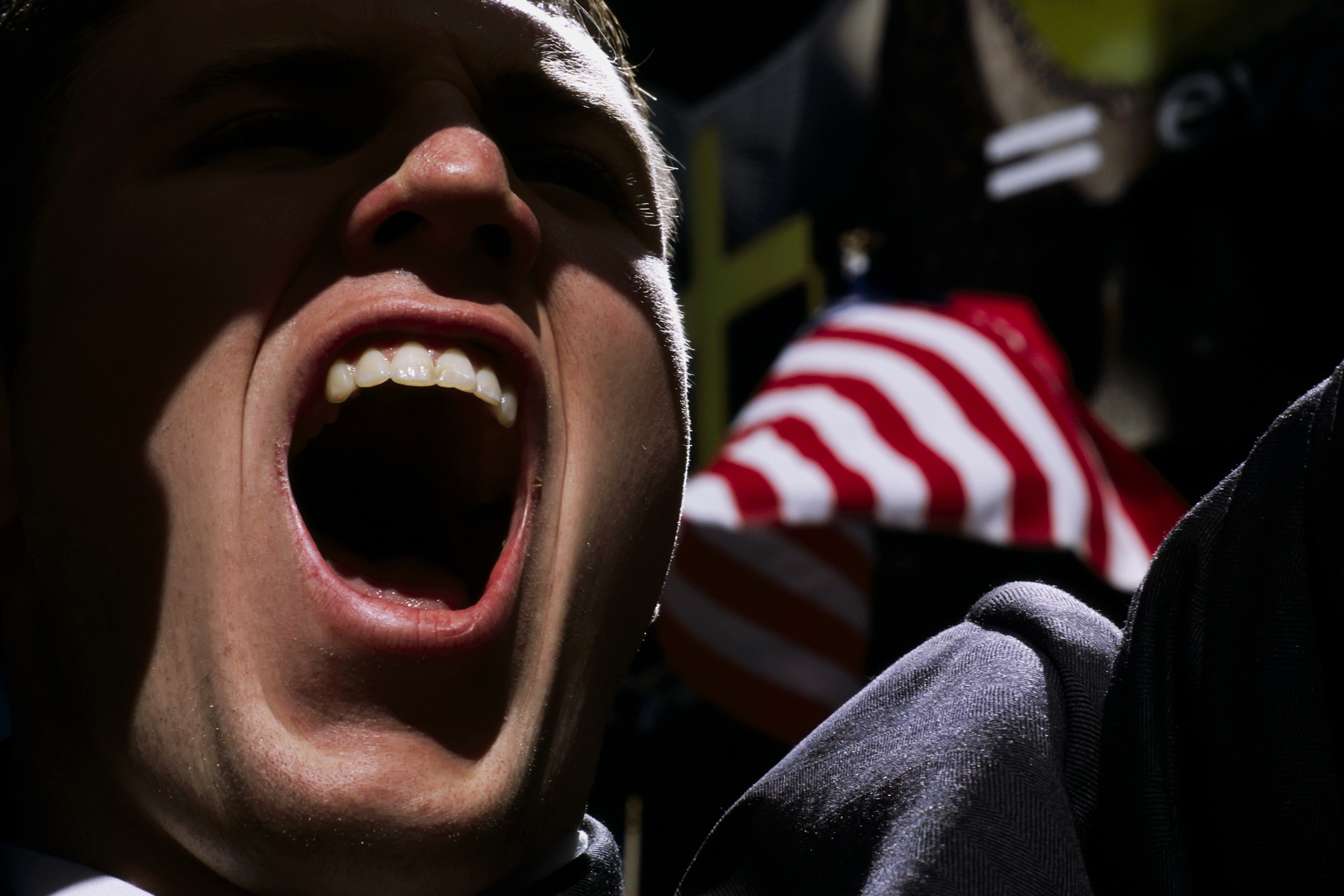 A Columbia University Law student screams in support of the bombing of Iraq at a demonstration held prior to the invasion. .  Others at the demonstration held signs advocating the nuclear destruction of Baghdad.   