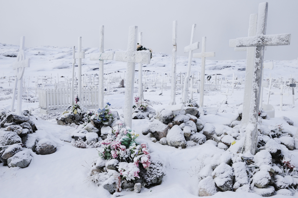 Graves covered by snow along the coast line of Illusissat.