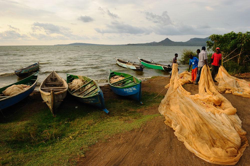 """Stanley Greene (C) NOORIMAGES-2010 Kuvua Samaki MwangazaniHunting the fish into light """"Spreading the net """"Nyachebe Solar Fishermen -Mbita ,Kenya"""
