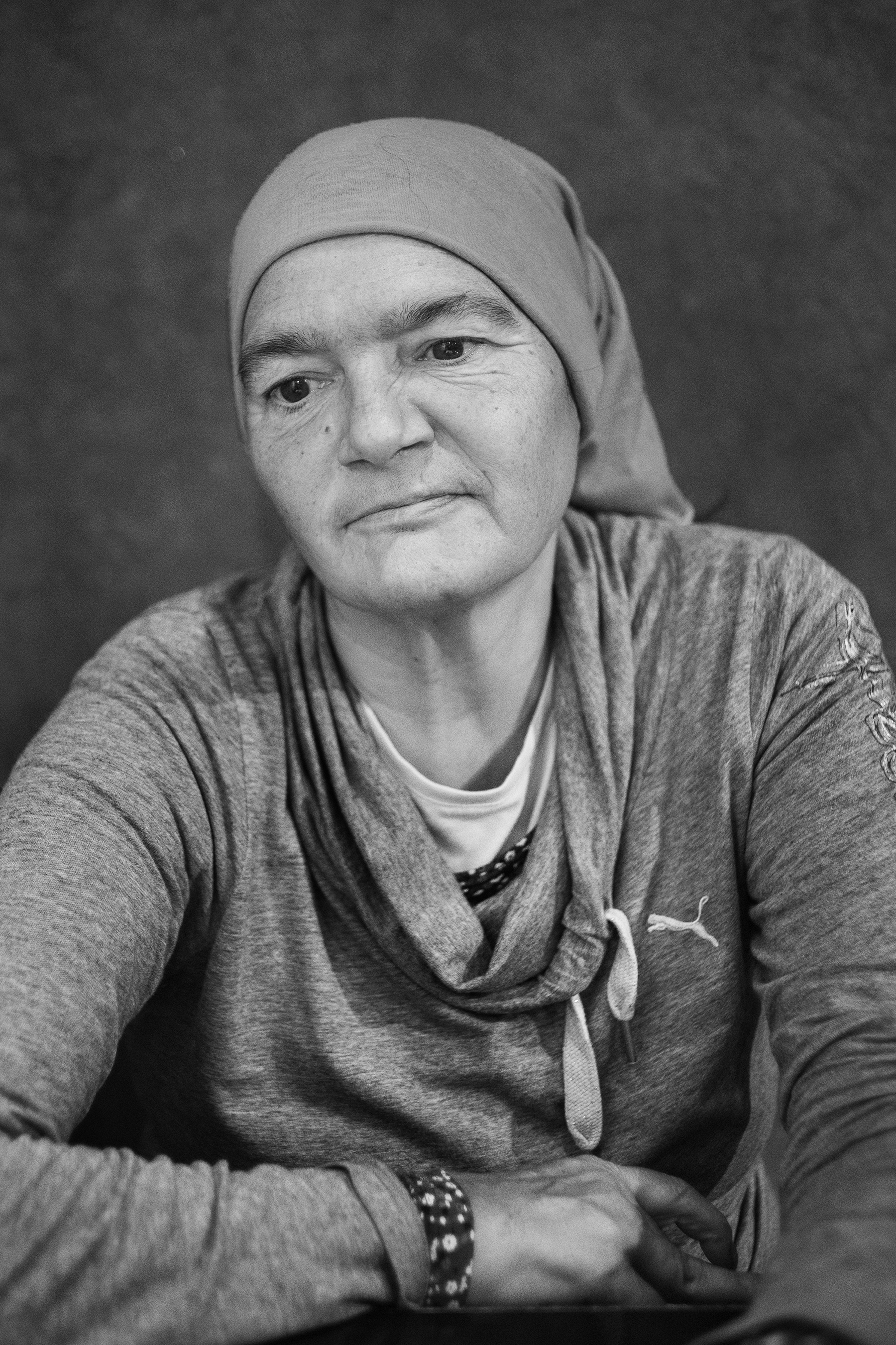 Tiziana Sfreddo (59) portrayed in the district of San Salvario in Turin, Italy; November 2018.Ms. Sfreddo lived 4 years in an occupied abandoned factory; at the beginning of her life on the streets, she stayed 3 months without a proper shower, before discovering the Public Baths.