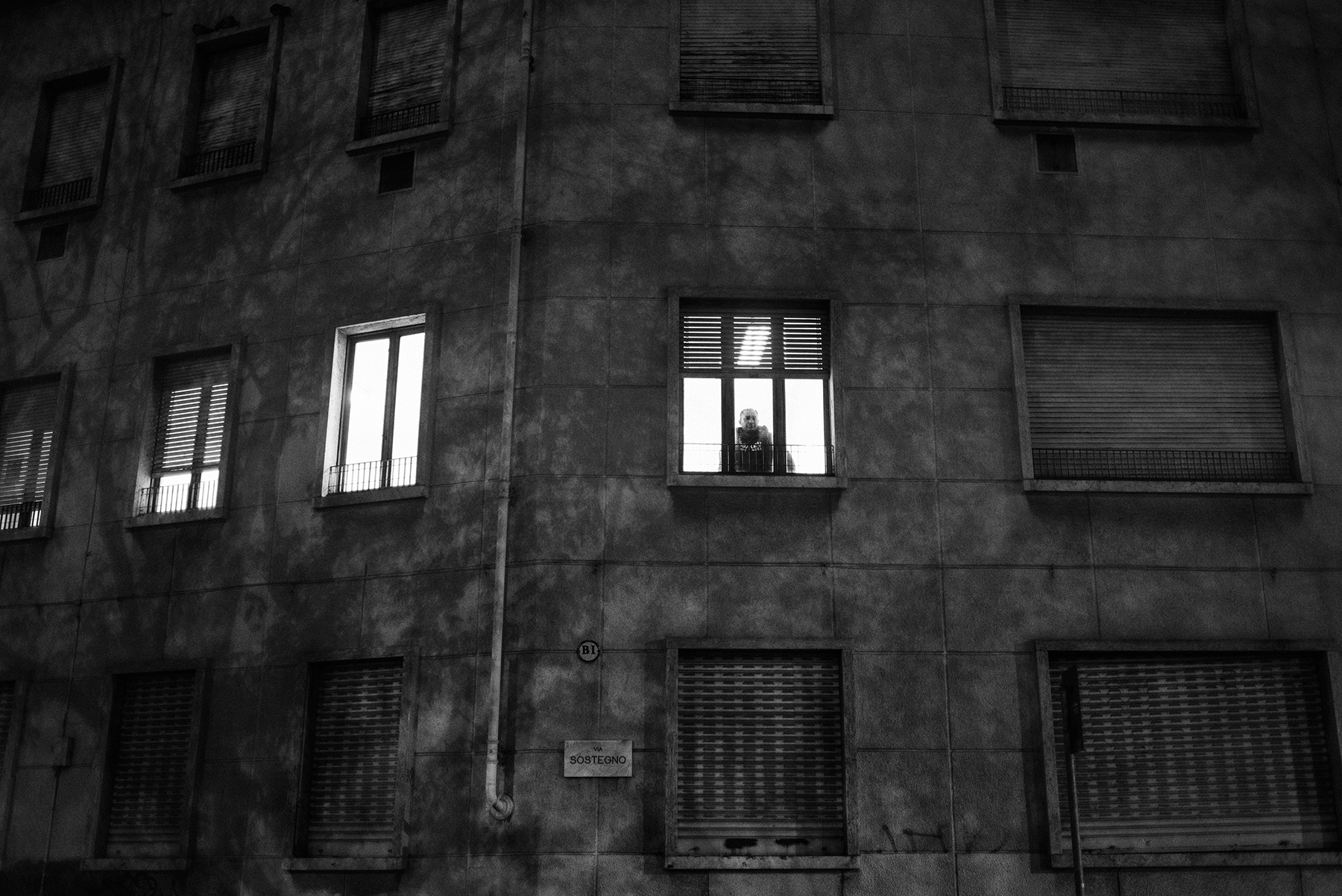 Gurpreet Dhindsa (38) looks out the window from the Red Cross dormitory in Piazza Massaua in Turin, Italy; December 2018.After being kicked out, Mr. Dhindsa passed the following nights on the waiting room of a near hospital and he is now forced to sleep in public dormitories, such as the one in Piazza Massaua, and use public showers.