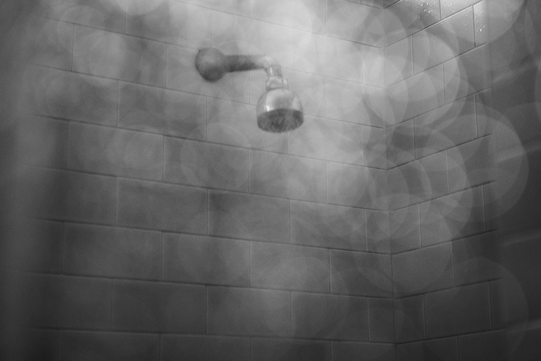 A shower at the Public Baths of Via Agliè in the working-class district of Barriera di Milano in Turin, Italy; July 2017.Turin has the highest rate of evictions/population in Italy: 2799 forced evictions were executed in 2017 only, on a total of 32,069 in the whole country. An average of 7 every day.