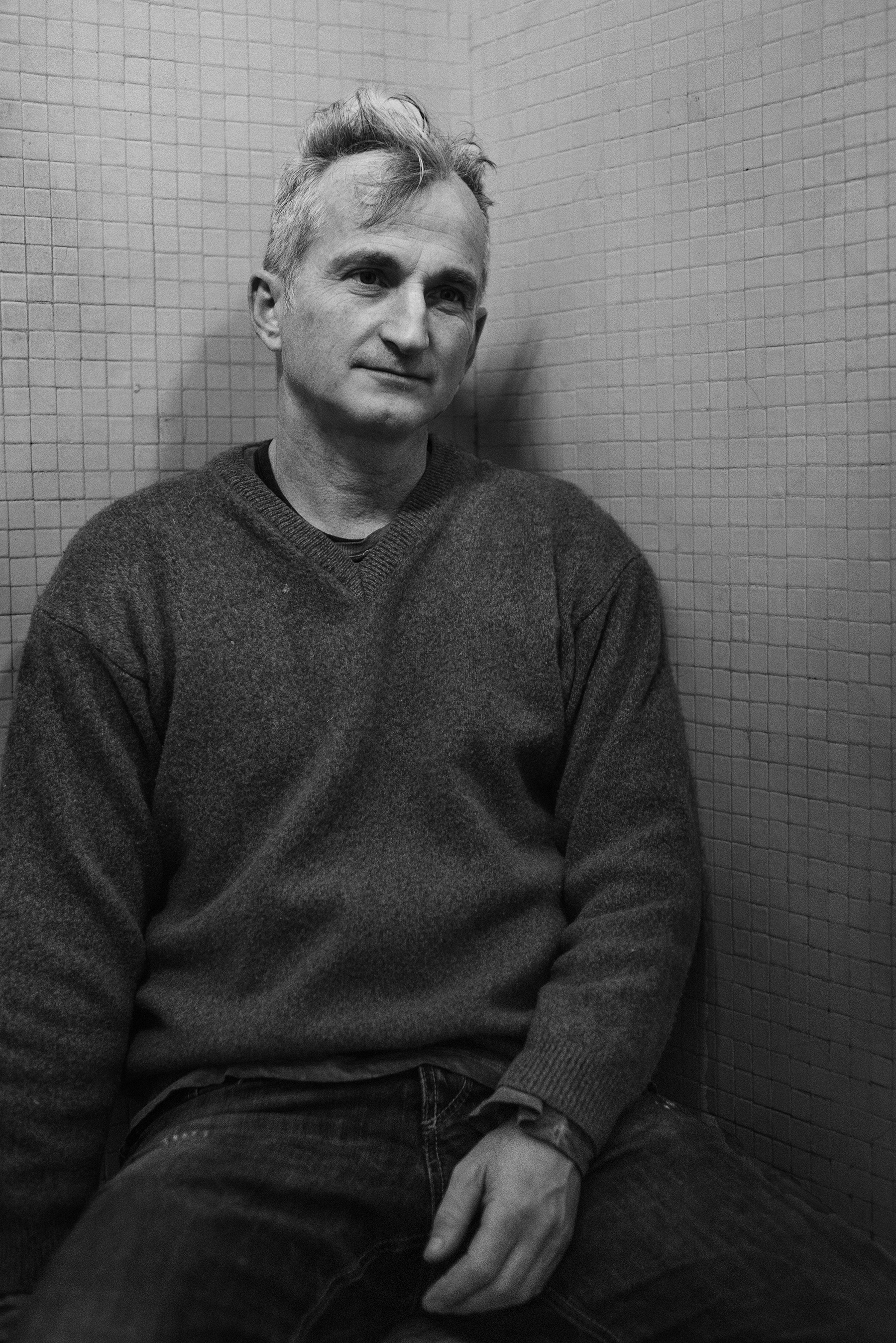Andrea Rosso (45) portrayed inside the Public Baths of Via Agli� in the working-class district of Barriera di Milano in Turin, Italy; November 2018.Mr. Rosso separated from his ex-wife in July; since he couldn�t afford a space for himself, he is now hosted on friends� couches - changing 9 places in 5 months � and became a regular user of Via Agli��s Public Bath.