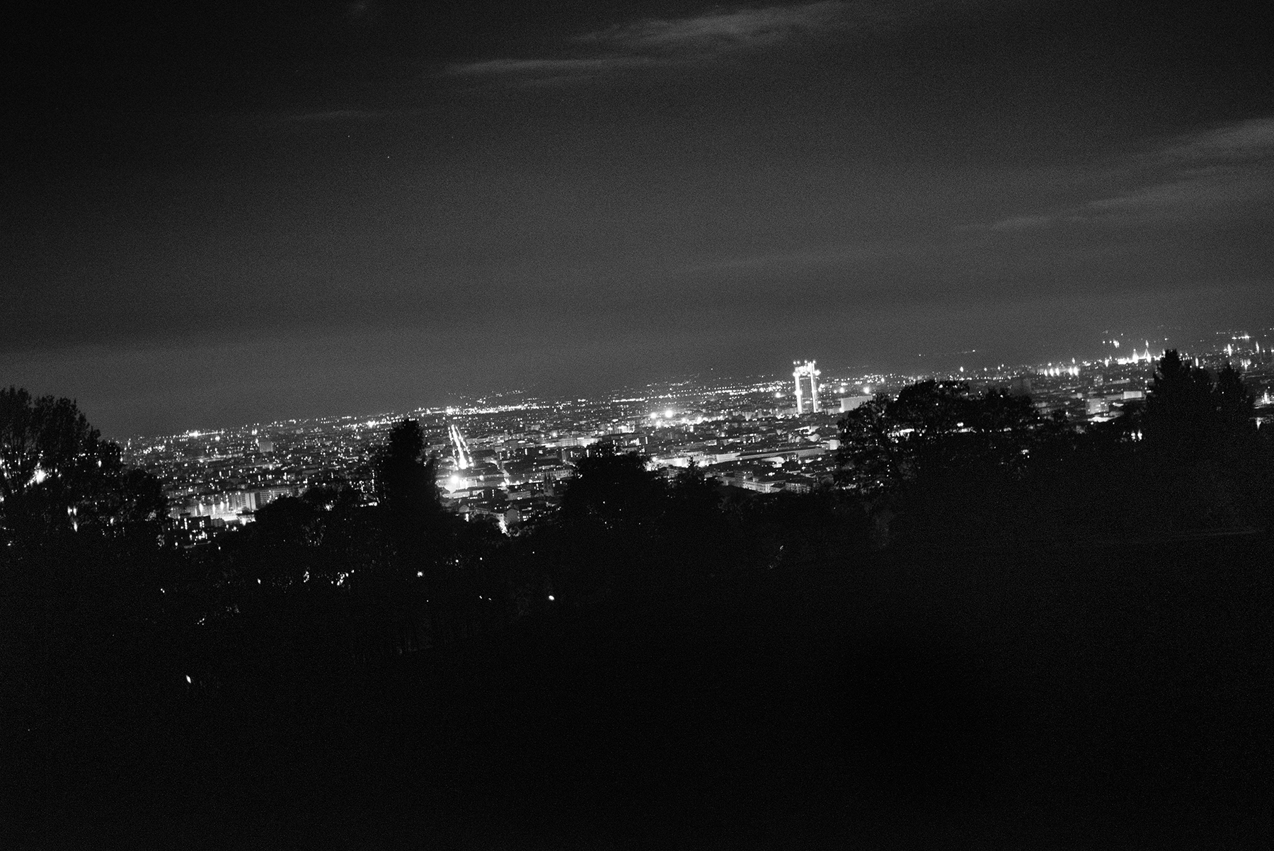 A view of the city of Turin at night from its surrounding hills, Italy; November 2018.Since the beginning of the XX century, Public Baths in Turin played a key role in mitigating the systemic housing crisis, worsened in the past years due to the city�s economic downfall.