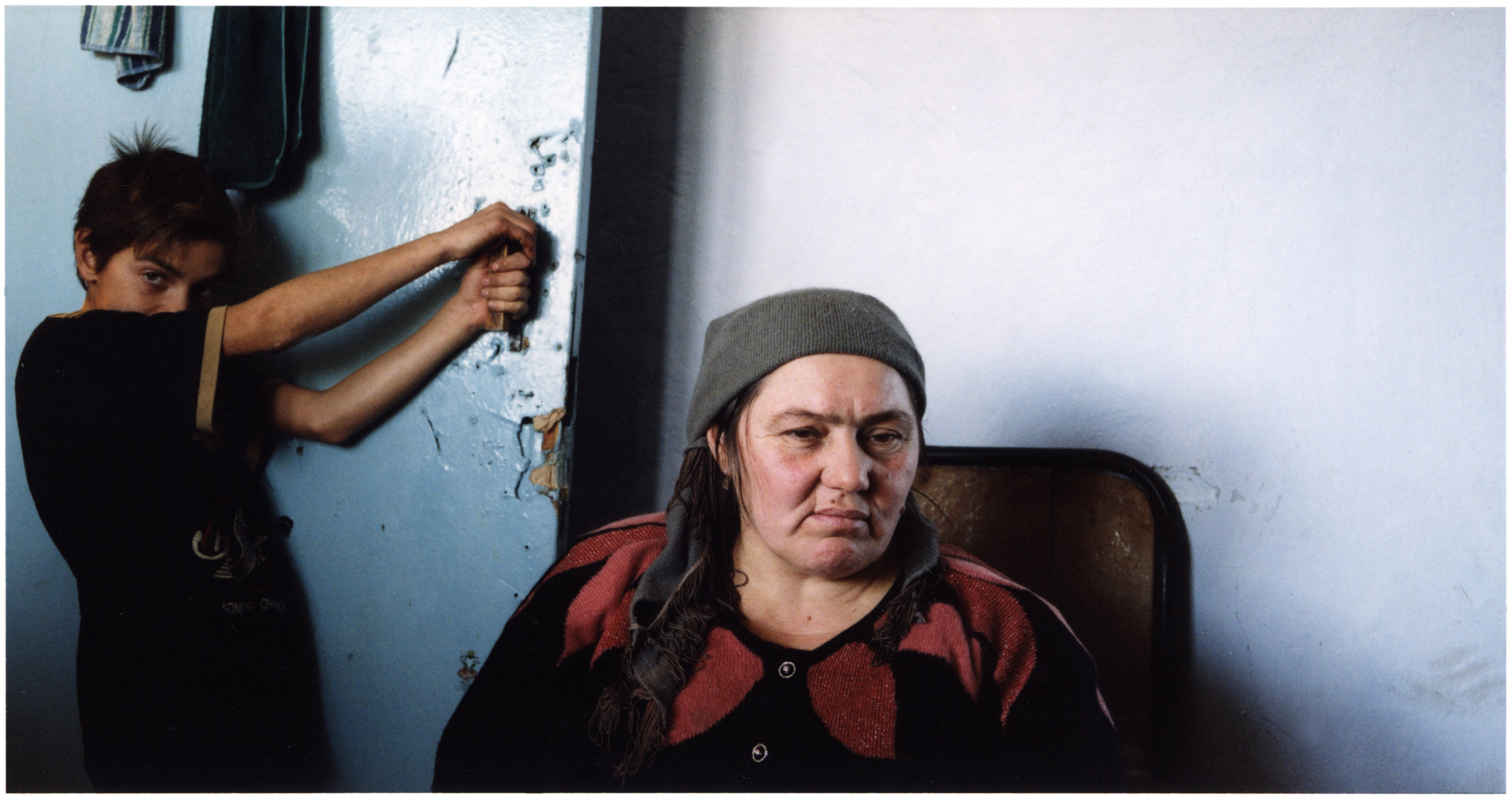 "January 2003, Marhet Magomadova, 41, with one of her five children. ""I am frightened of going back to Argun (near Grozny)"", she says. ""My children are scared too.They saw their father and uncle die in front of them. They were shot under our eyes by a Russian helicopter gunship."""