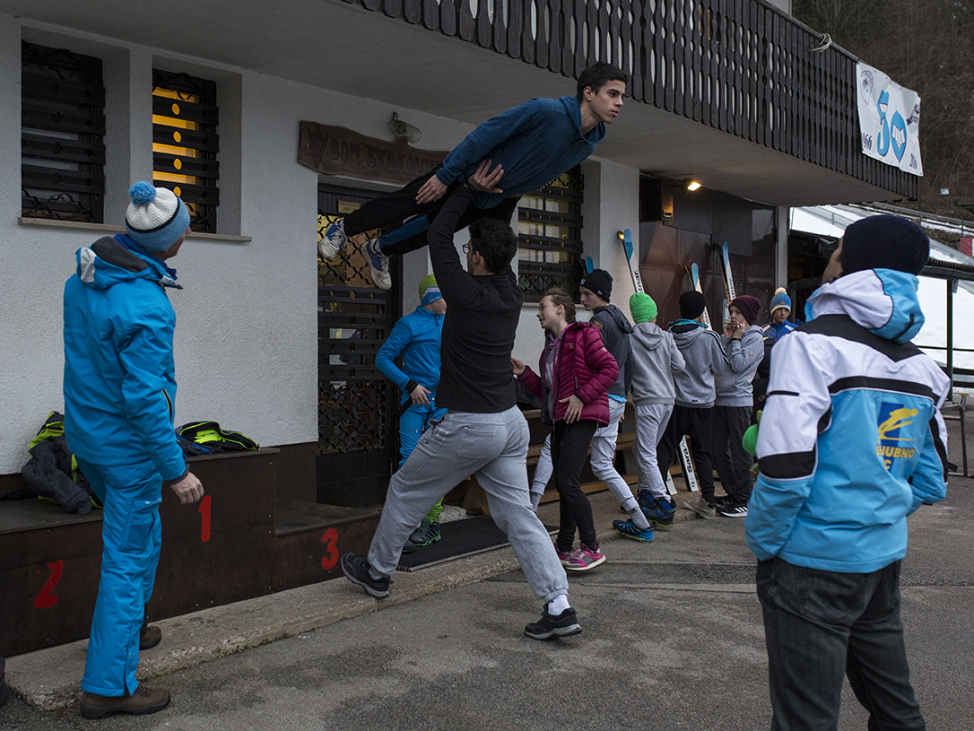 The coach from the club help Nikola to stretch well.Ljubno, Slovenia/2019 Photo/ Vladimir Zivojinovic