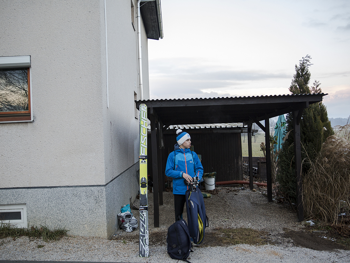 Nikola waiting for the bus in front of his new home in Slovenia, February 2019. Photo/ Vladimir Zivojinovic