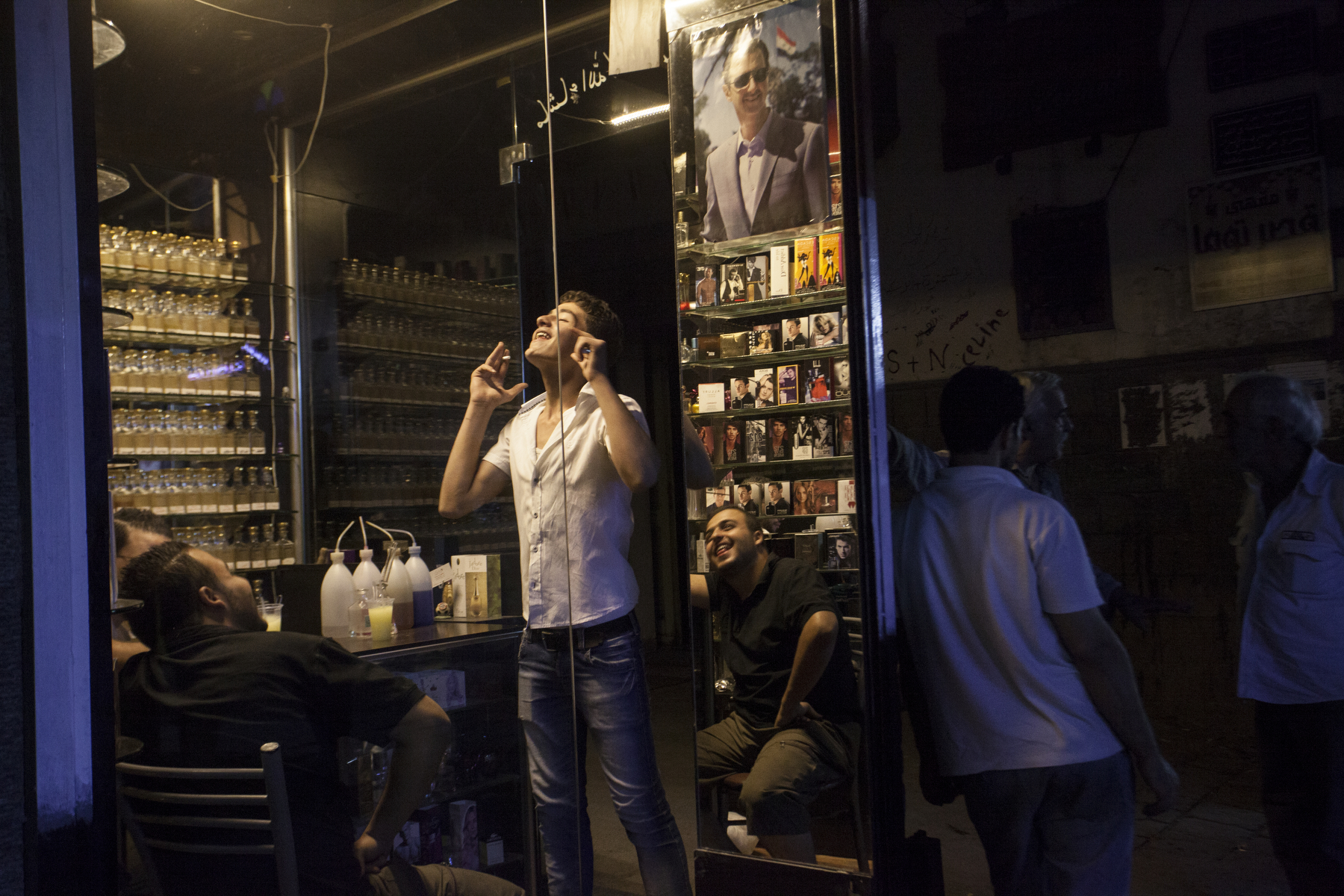 Damascus, 2015, Men hang out in a shop in the Old City of Damascus.