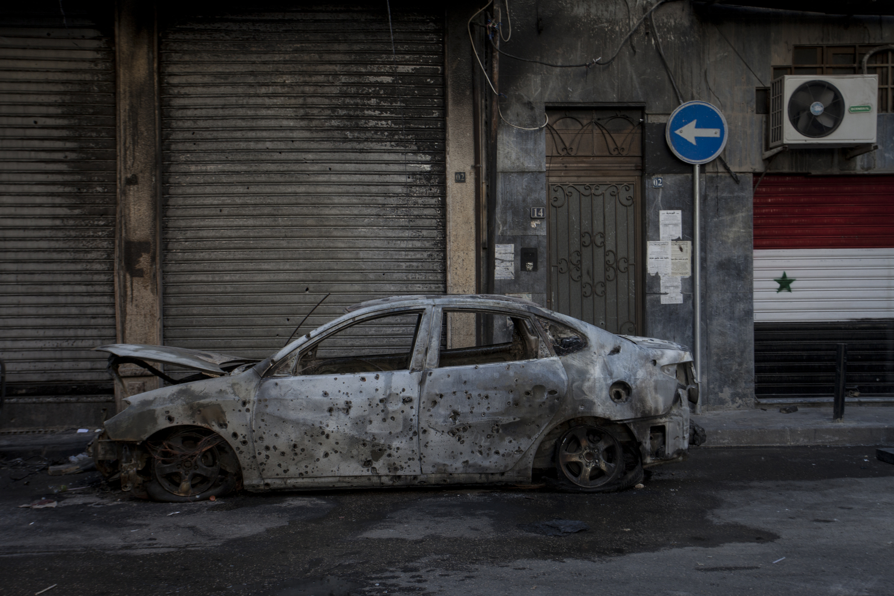Damascus, 2015, A burnt car in the downtown Salhiya district of Damascus, a day after a mortar fell on the street, launched from the rebel-held area.