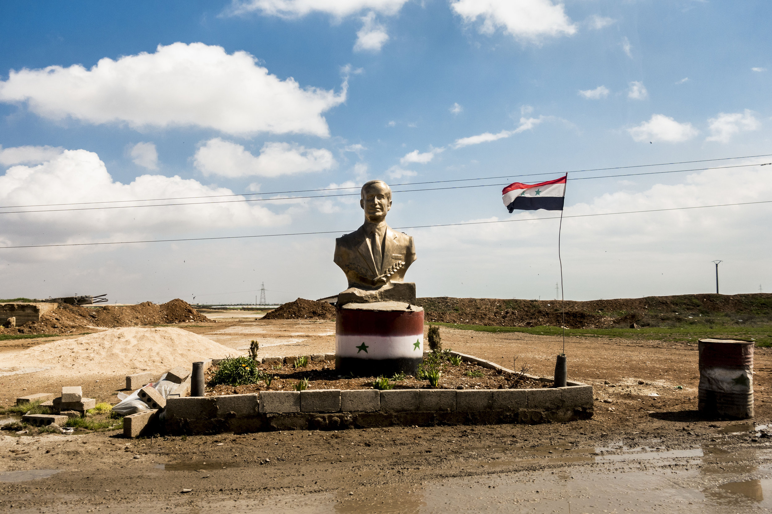 Syria, Aleppo, 18 March 2017  Statue of Hafez al-�sad, father of the President Bashar al Assad, in the only road secured by the government from Aleppo to Damascus.  Sebastian Liste / NOOR