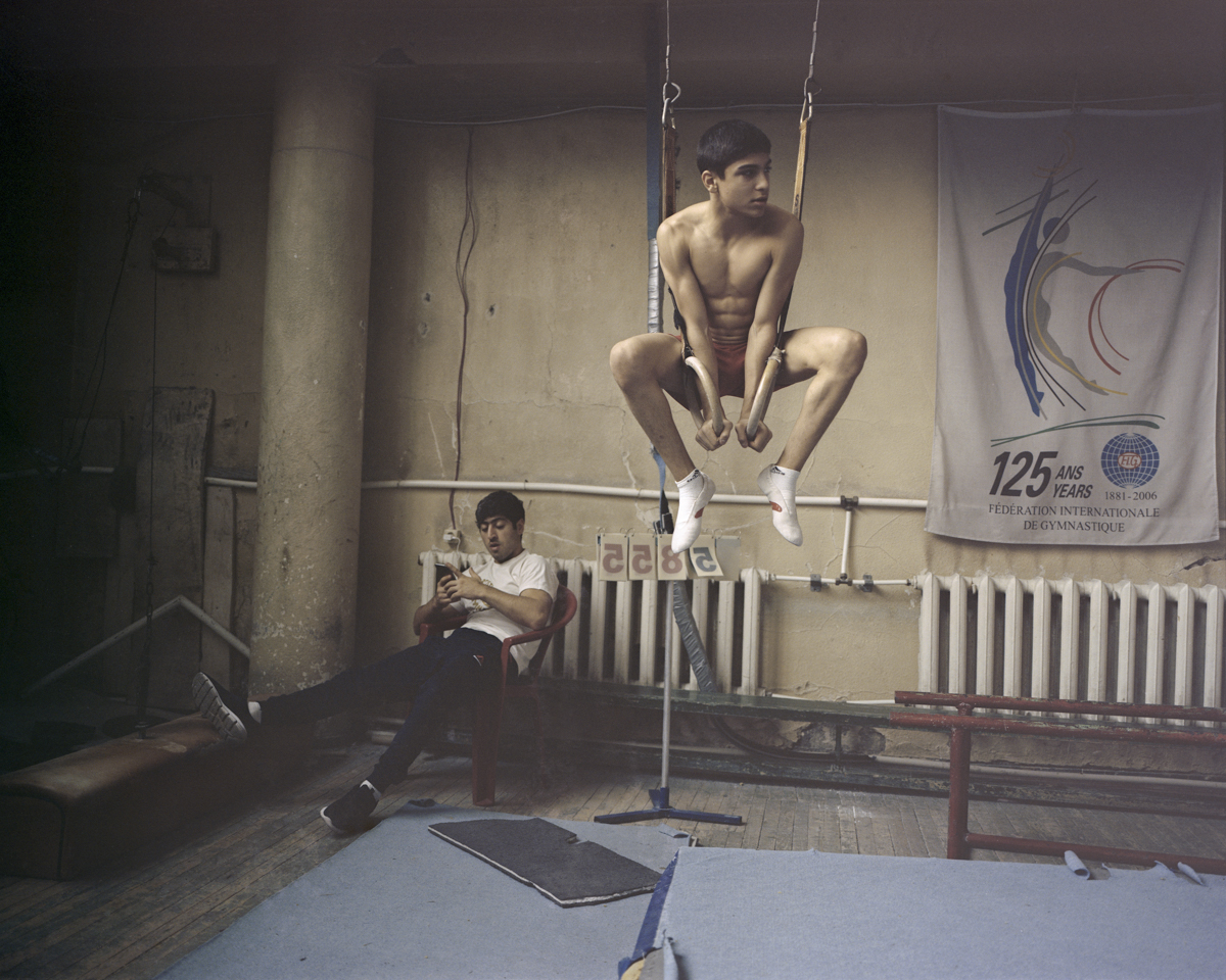 Gagik Xacikyan, multiple youth champion of athletics, is waiting for his daily training in one of the oldest gyms named after the two times Olympic Champion, Albert Azaryan.