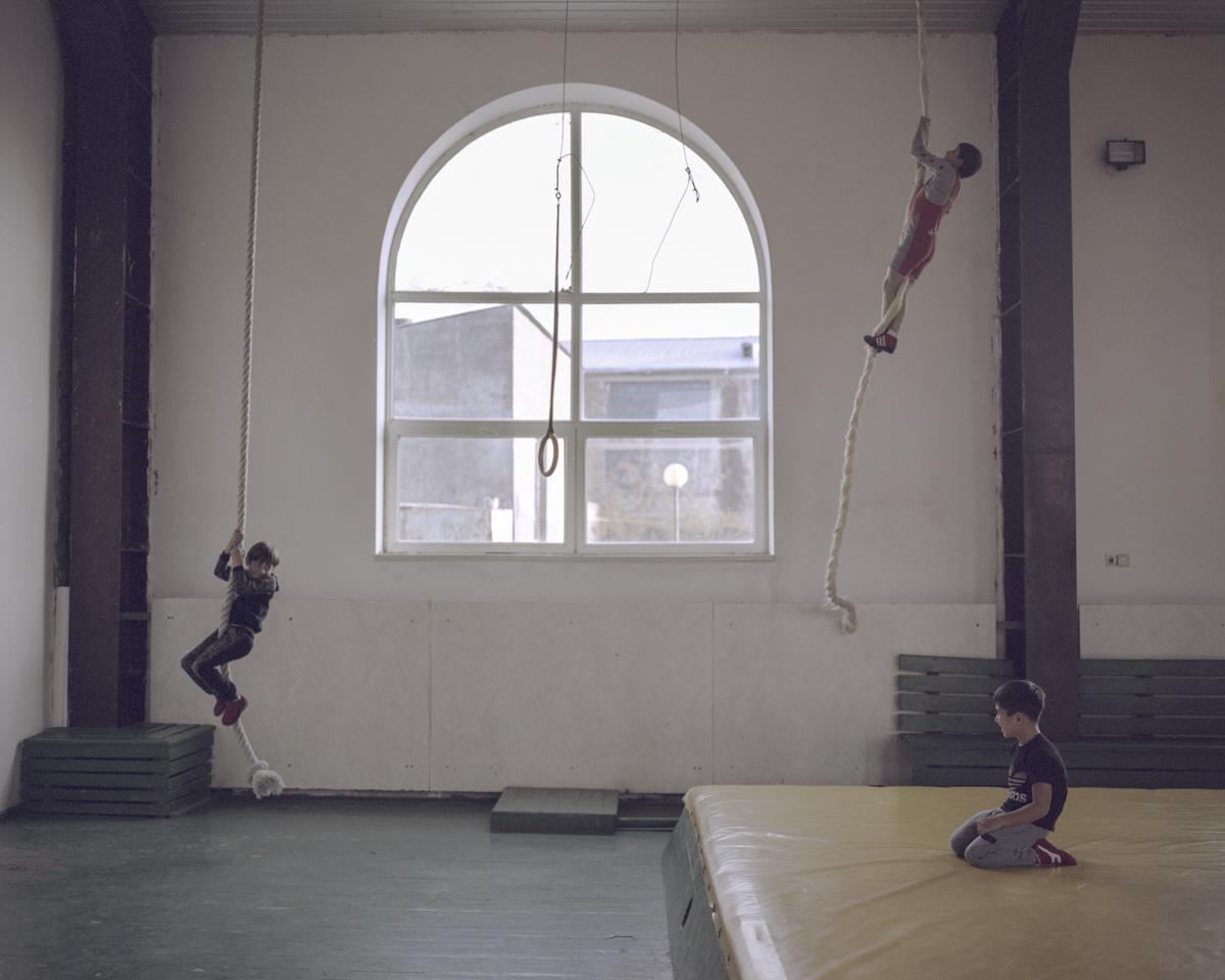 Before training kids playing around the matress in Garni.
