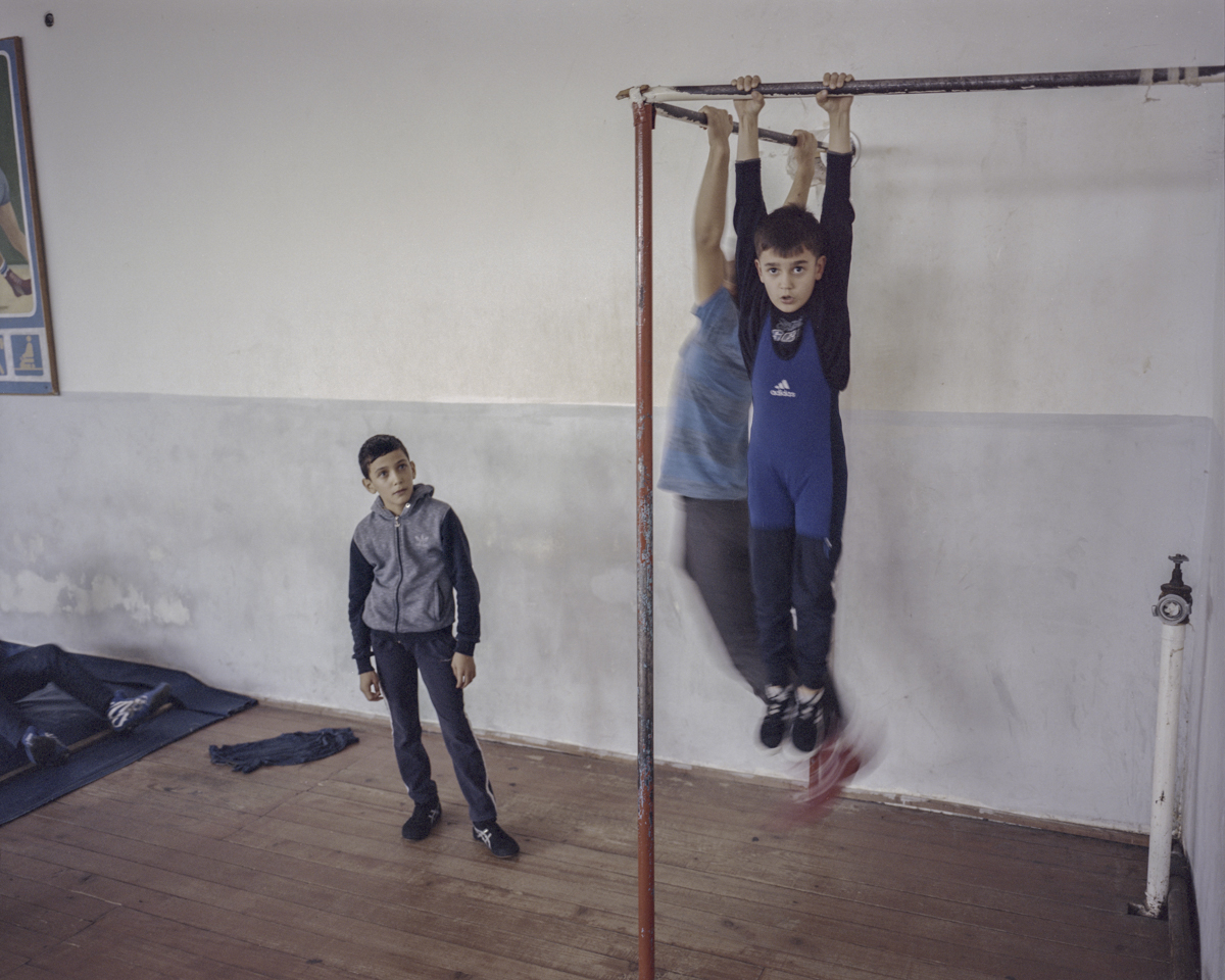 The training methods are sometimes very painful. Children do their fitness training in Etchmiadzin in order to gain muscles.