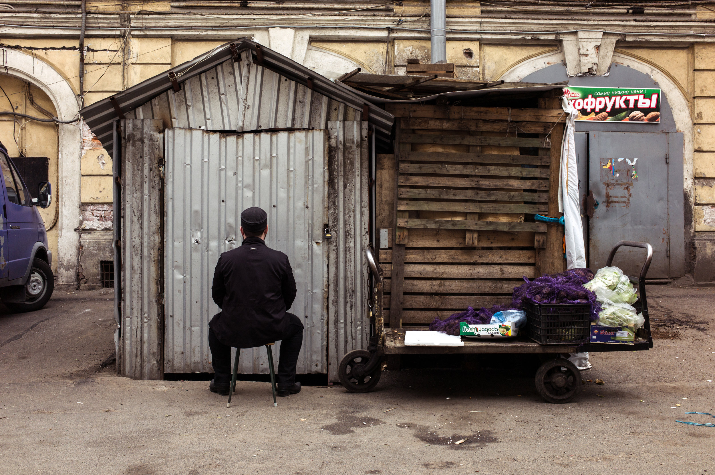 Russia, Saint-Petersburg, 17 May 2015. X, 28, is photographed next to a building which used host a makeshift mosque, now closed, where he converted about 6-7 years ago. He got interested in Islam by randomly opening a web site dedicated to this religion. He asked not to be identified as he still resides in Russia.