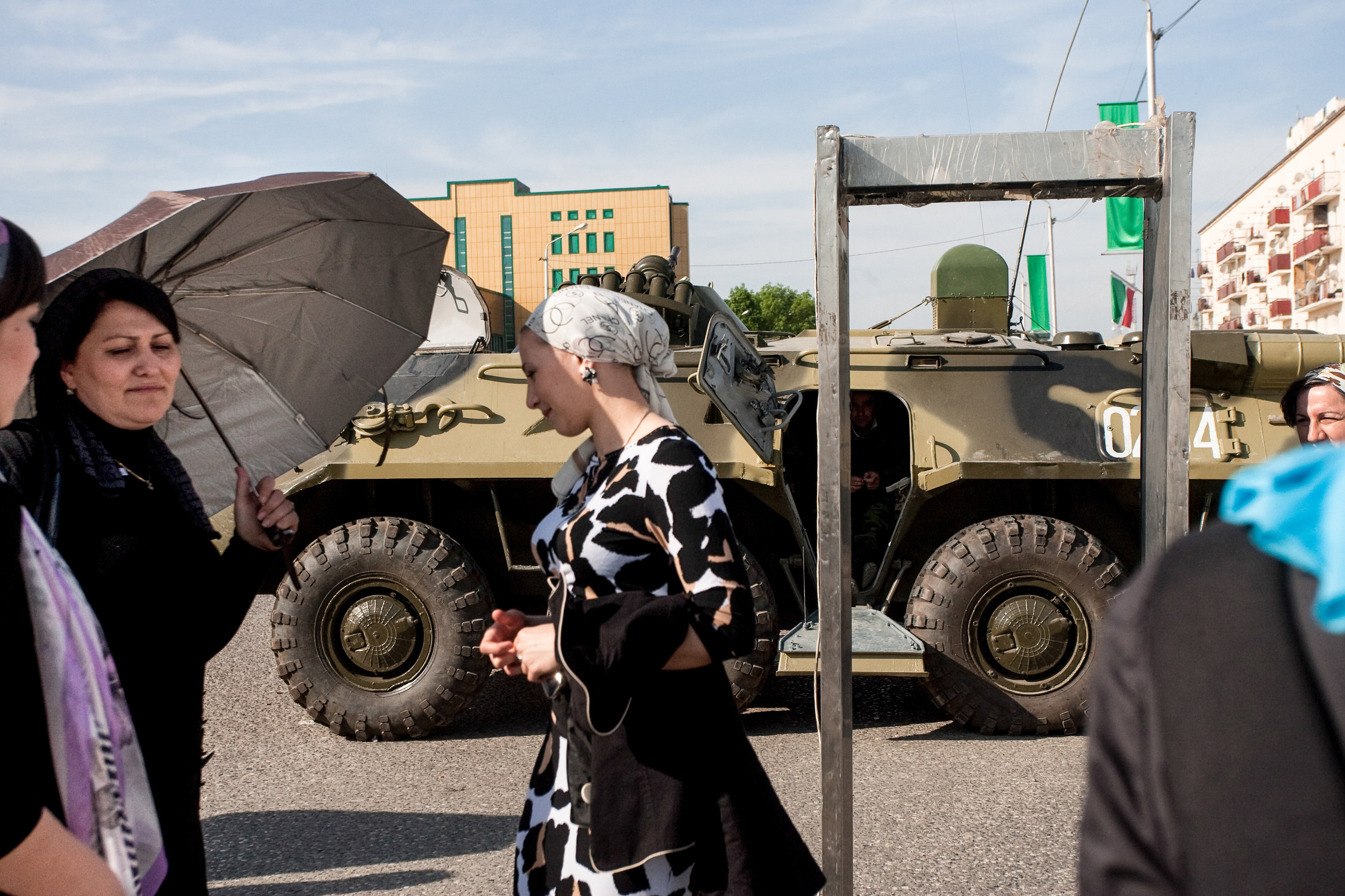 Russia, Chechnya, Grozny, 9 May 2010. Women waiting to check people's bags as they go through a metal detector at the boundary of central Grozny, just before a Victory Day parade marking the end of World War II.
