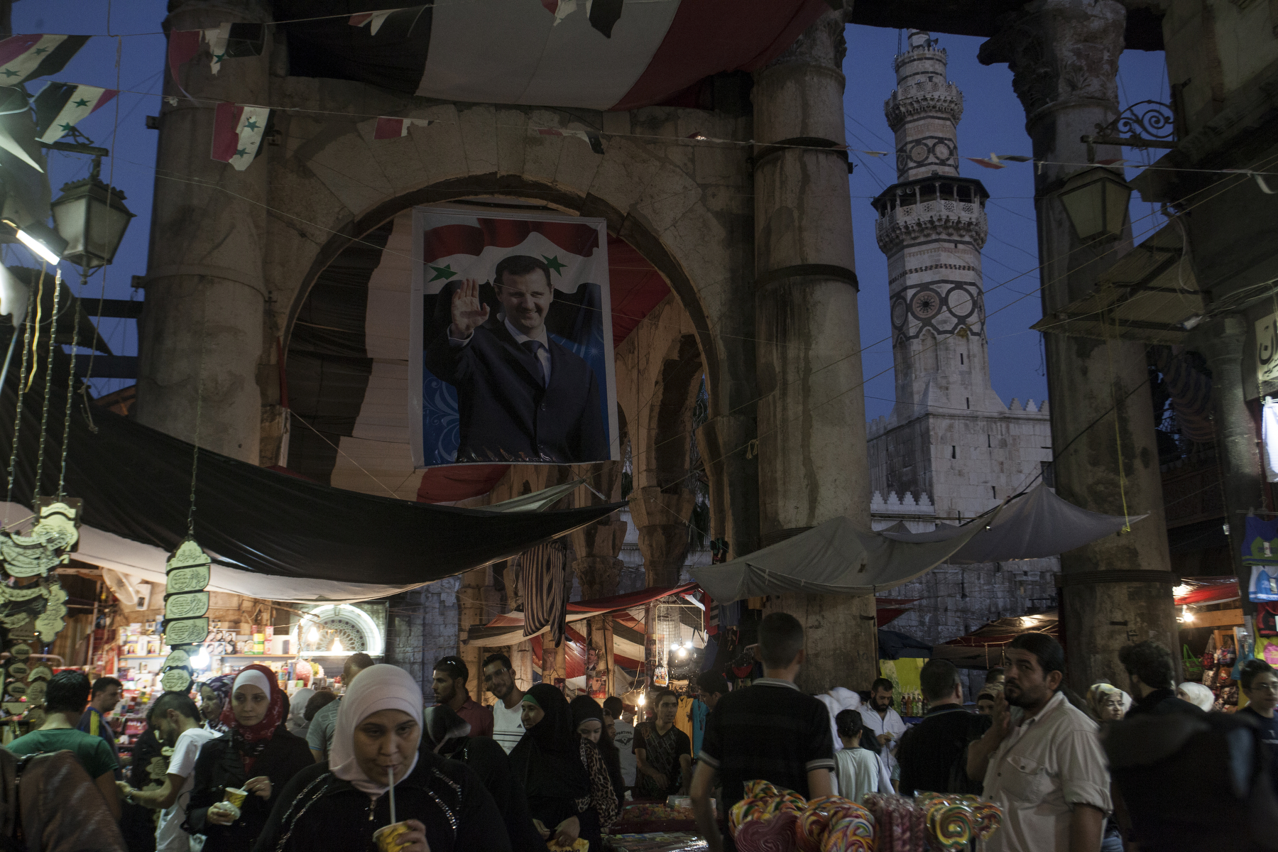 Damascus, 2015, People walk by the market street leading to the Umayyad Mosque, also known as the Great Mosque of Damascus in the Old City.