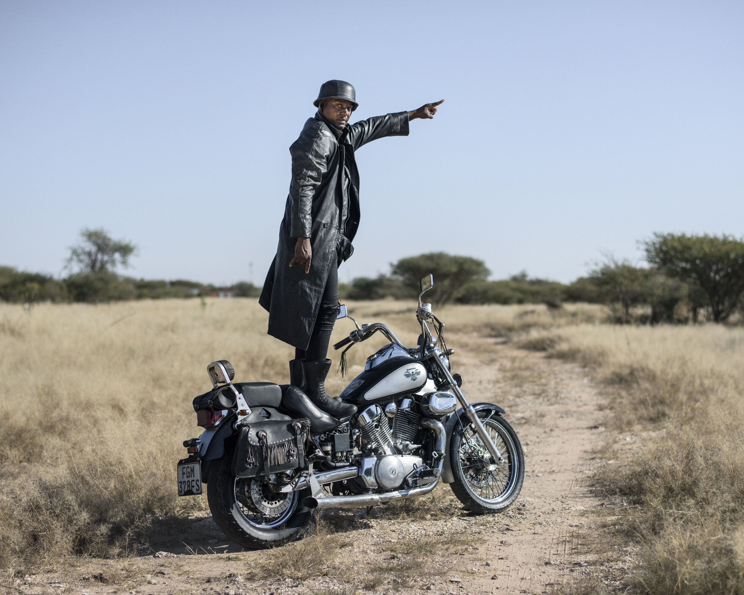 """Botswana, Ghanzi, May 2017""""Vulture"""" 32 years old Overthrust front man, bassist and lead vocalist. I am a rocker, I live for rock n roll and I´ll die a true, loyal metal warrior, anything that is not metal doesn't make sense to me, I love metal. I started listening to metal at the age of 13 years when I was in a primary school in 1998, I stayed with my uncle Dux Drug Dee, Master and my other cousins who were metal heads and always playing metal around me, I got influenced and they gave me some metal music and attire, they gave me cassettes from Cannibal Corpse, Metallica, Iron Maiden and Def Leppard, so I listened to them everyday, I completed my studies in 2007 and became a cop, I met my cousin Spencer in 2008 and we started Overthrust, I sold my motorcycle – 1100 YAMAHA, to buy basic band instruments, Suicide joined us as a drummer, I was the bassist and vocalist and Spencer the guitarist, 2010 we became very active and started attending shows, Godfather and Dawg joined us in 2011 and 2013 respectively.Pep Bonet / NOOR"""