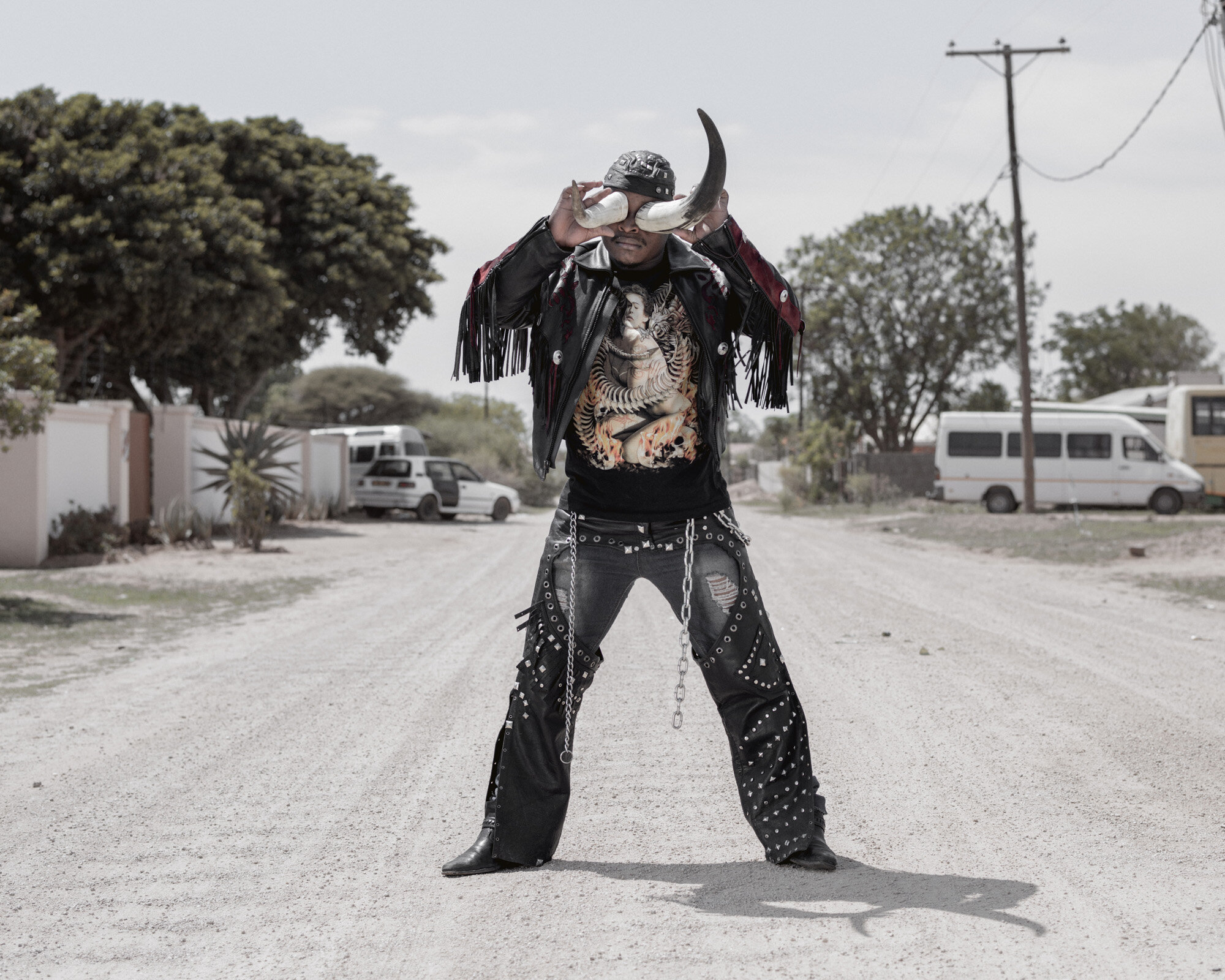 """Africa, Botswana, Gaborone, December 2015Photo by Pep Bonet / NOORPortrait of 27 years old """"Cybok""""I work as a security guard, I started listening to heavy metal in 2008, I liked the way the metal heads dressed and behaved so I started associating myself with them and I became a rocker, I like Skinflint, I'm new in the Industry."""