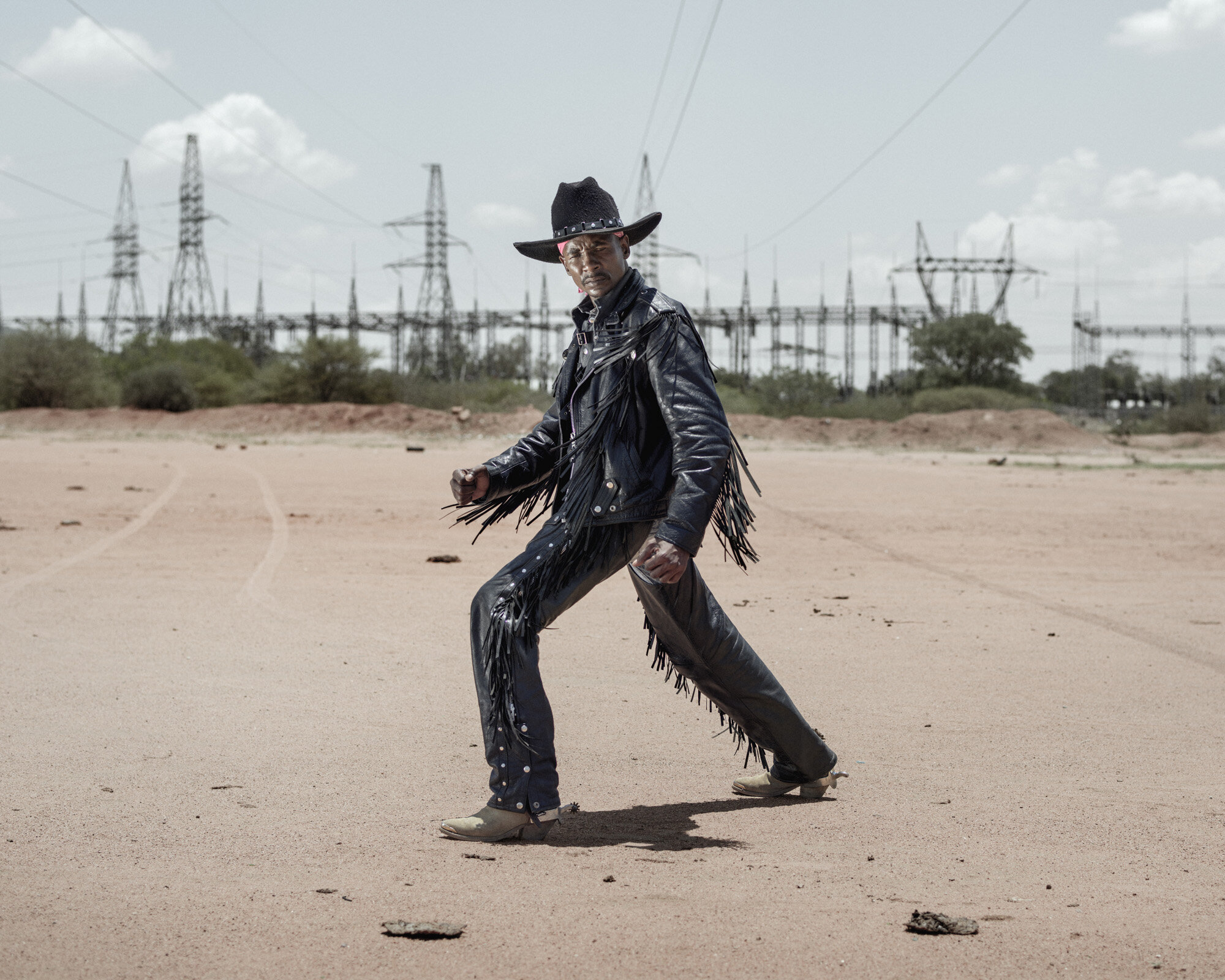 """Africa, Botswana, Gaborone, December 2015Photo by Pep Bonet / NOORPortrait of 40 years old """"Diplo""""I am a farmer, I started listening to metal music in 1999, my sister was married to a white man from England who heavily influenced me to listen to metal, by then I was just listening to that music not knowing it was called metal, up to until I learnt about metal and started buying metal attire for myself, I listened to bands like Led Zeppelin and Deep Purple."""