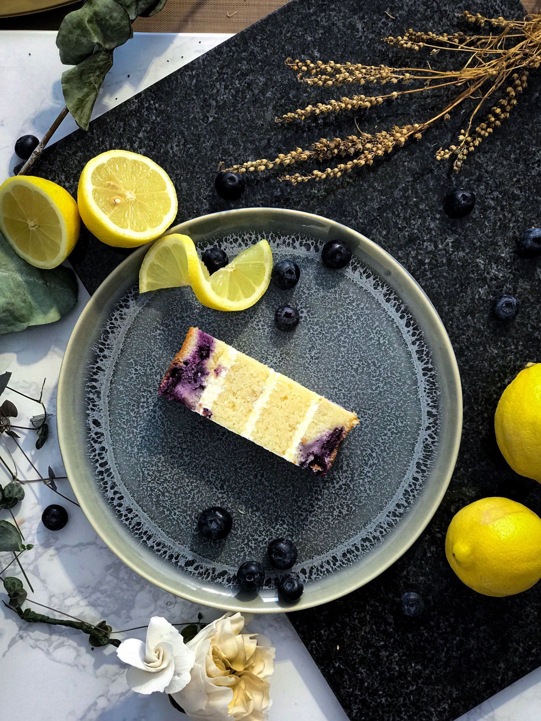 BLUEBERRY CHEESECAKE  love a light textured cake? This one's for you. Lemon & wild blueberry cake with a cream cheese filling in between the fluffy layers cake.