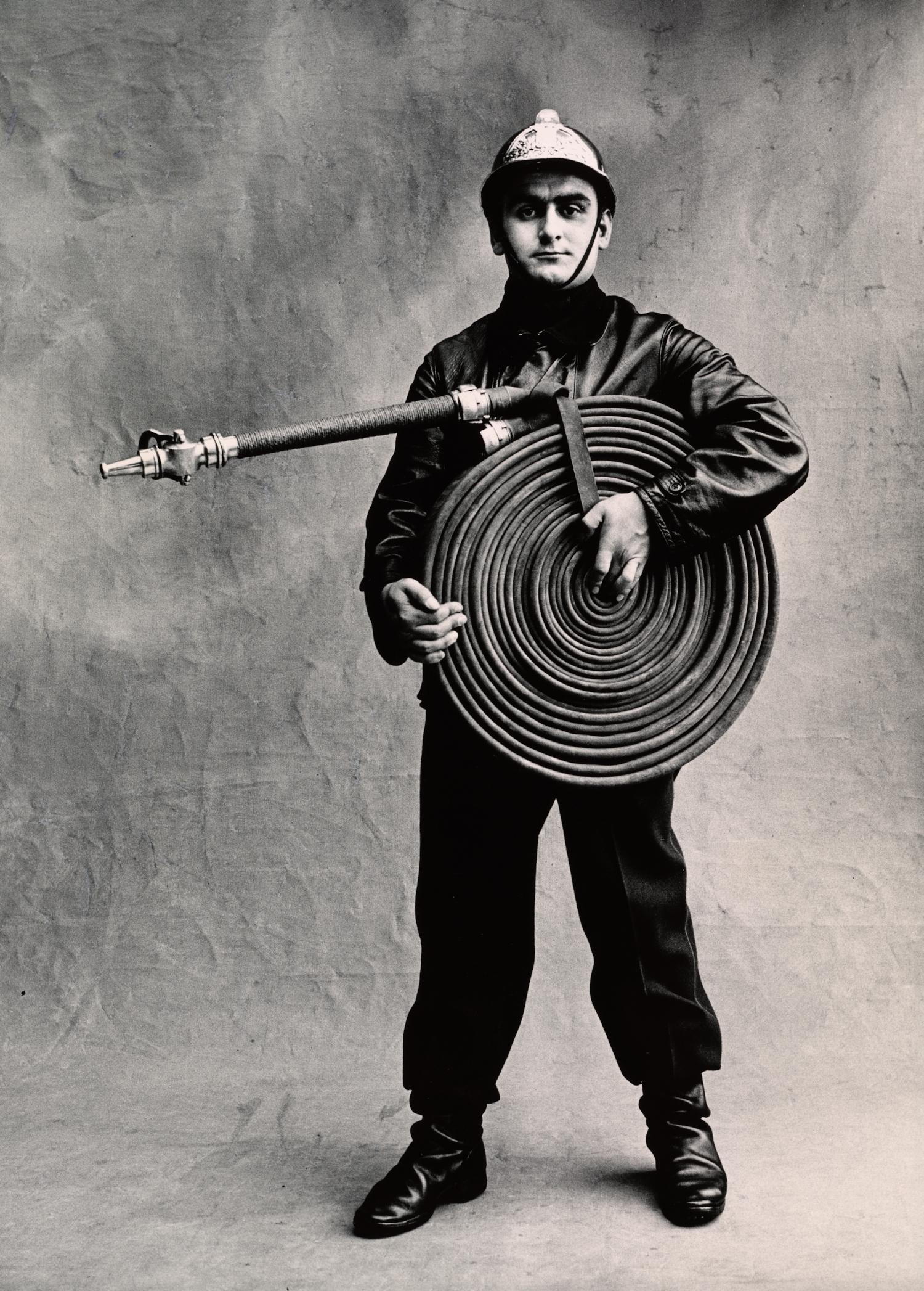Pompier , Paris, 1950 [Fireman] Gelatin silver print © Condé Nast (Fr.)