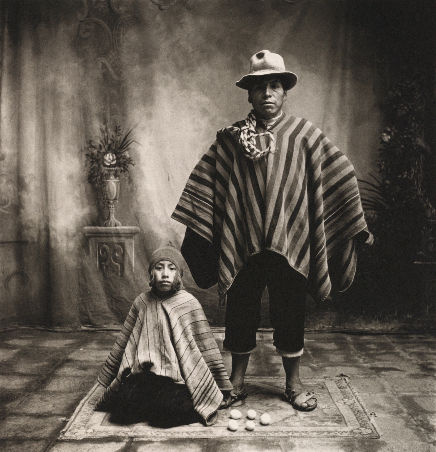 Father and Son with Eggs , Cuzco, 1948 Platinum-palladium print © The Irving Penn Foundation
